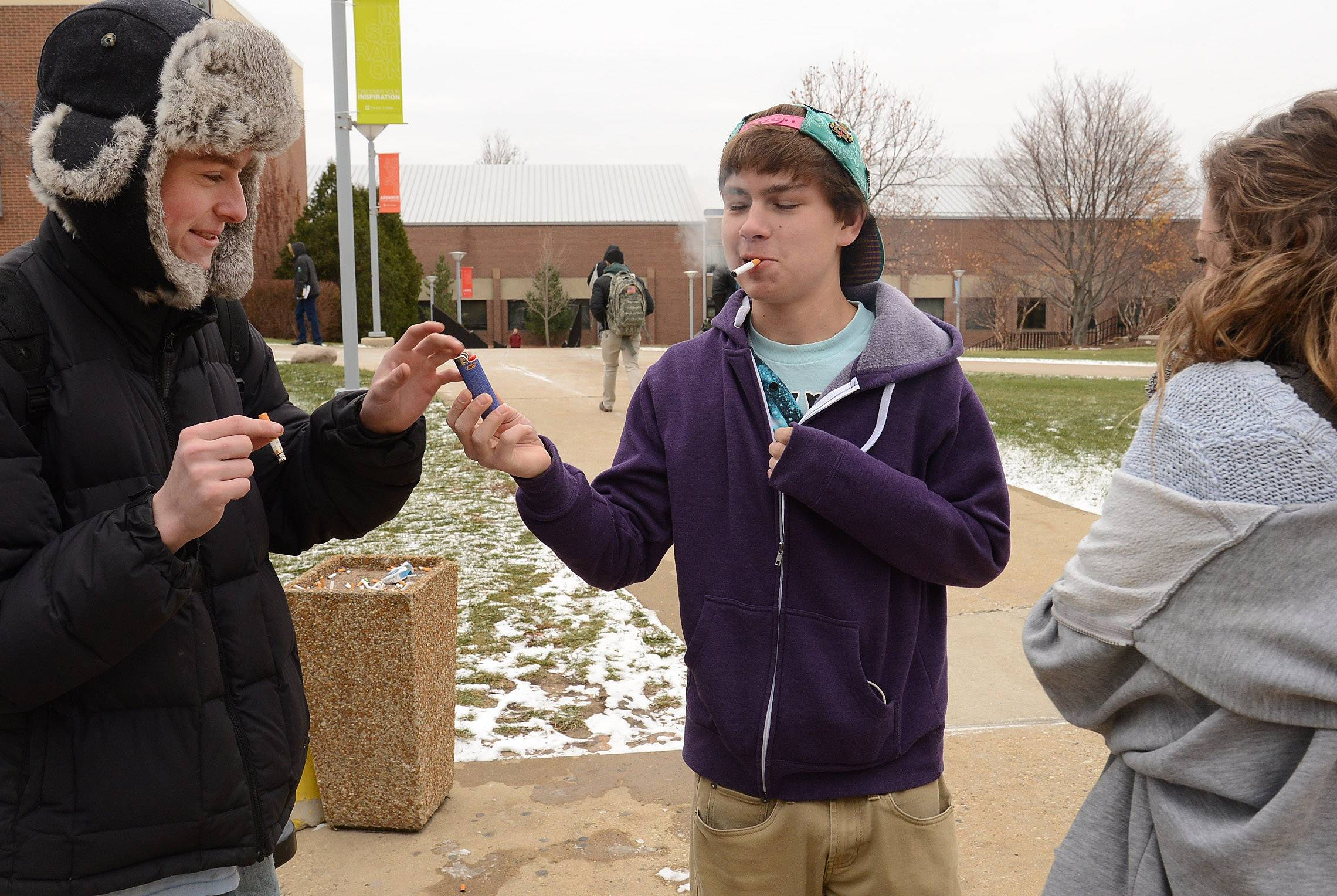 "Harper student John Ingham, center, of Buffalo Grove worries that students would face fines for ""smoking cigs when they're of age and they can smoke."""