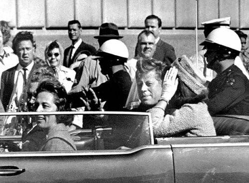 President John F. Kennedy and his wife, Jacqueline are shown riding in a motorcade moments before the president was fatally shot in November 1963.