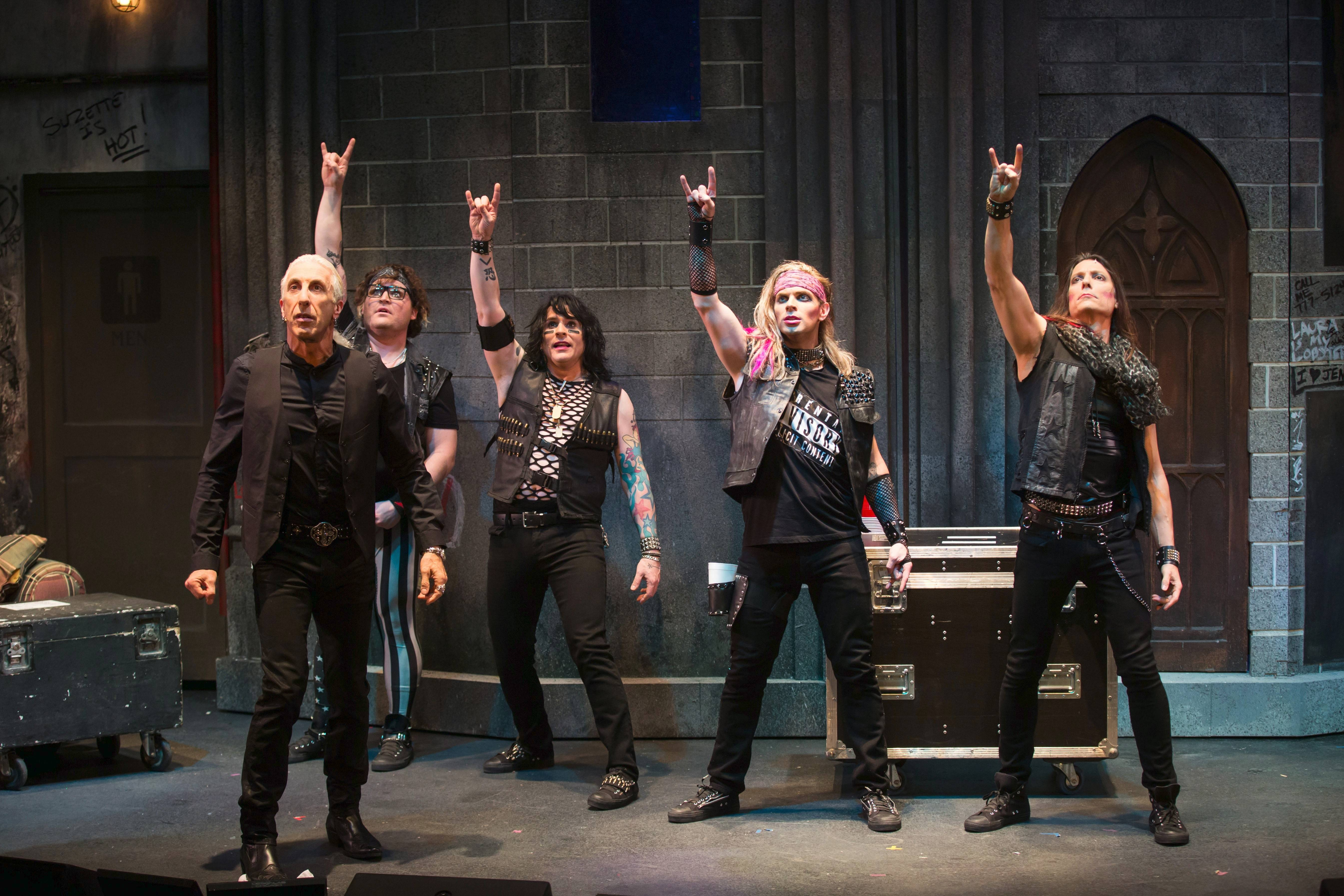 "Rock star and co-author Dee Snider, front, narrates the holiday story of the metal band D�isy C�tter featuring, left to right, Ralph (Wilam Tarris), Tank (Tommy Hahn), D.D. (Adam Michaels) and Johnny (Dan Peters) in ""Dee Snider's Rock & Roll Christmas Tale"" at the Broadway Playhouse at Water Tower Place in Chicago."