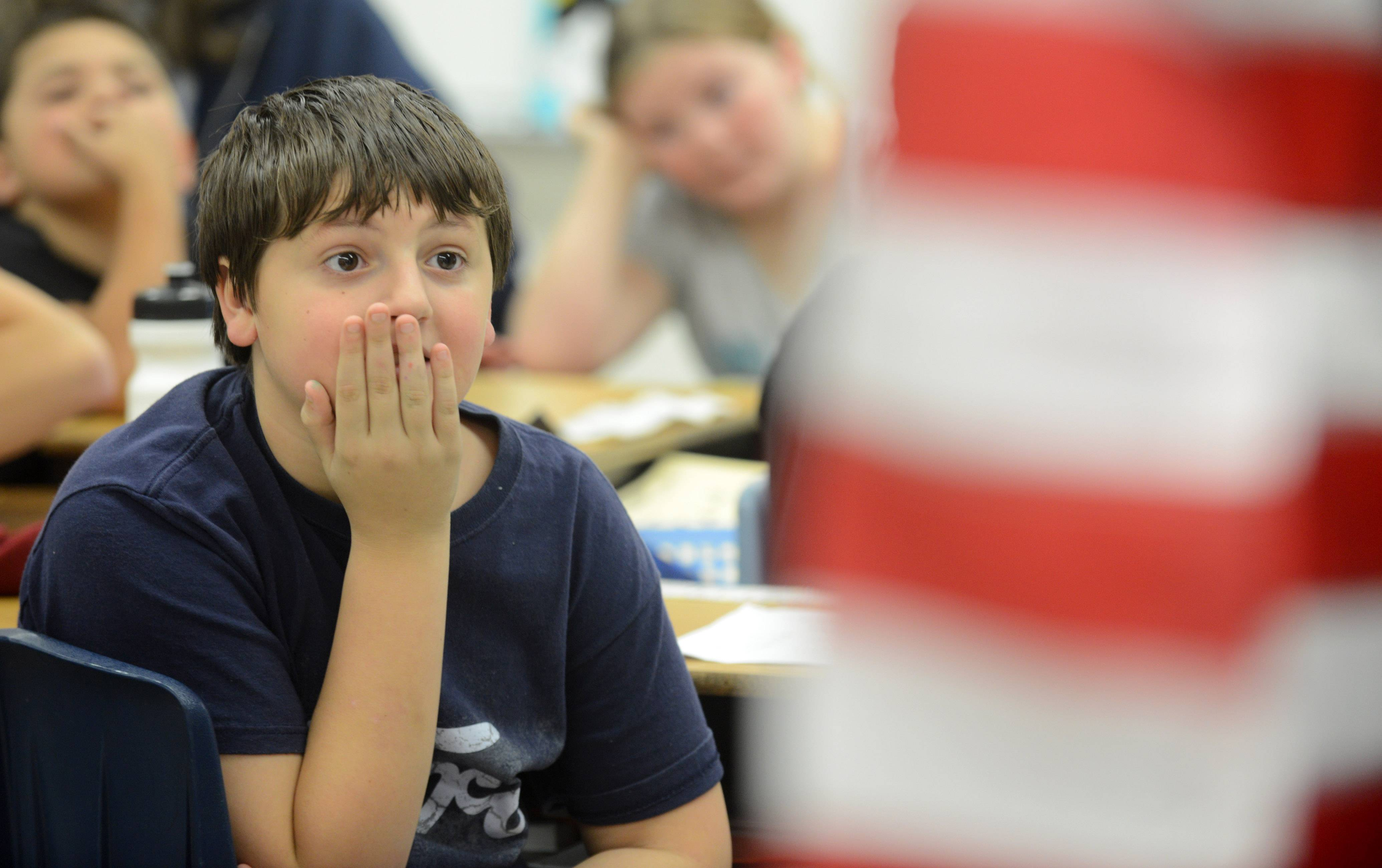 Zach Conro watches with rapt attention during a flag presentation for fifth-graders Friday at Willard Elementary School in South Elgin.