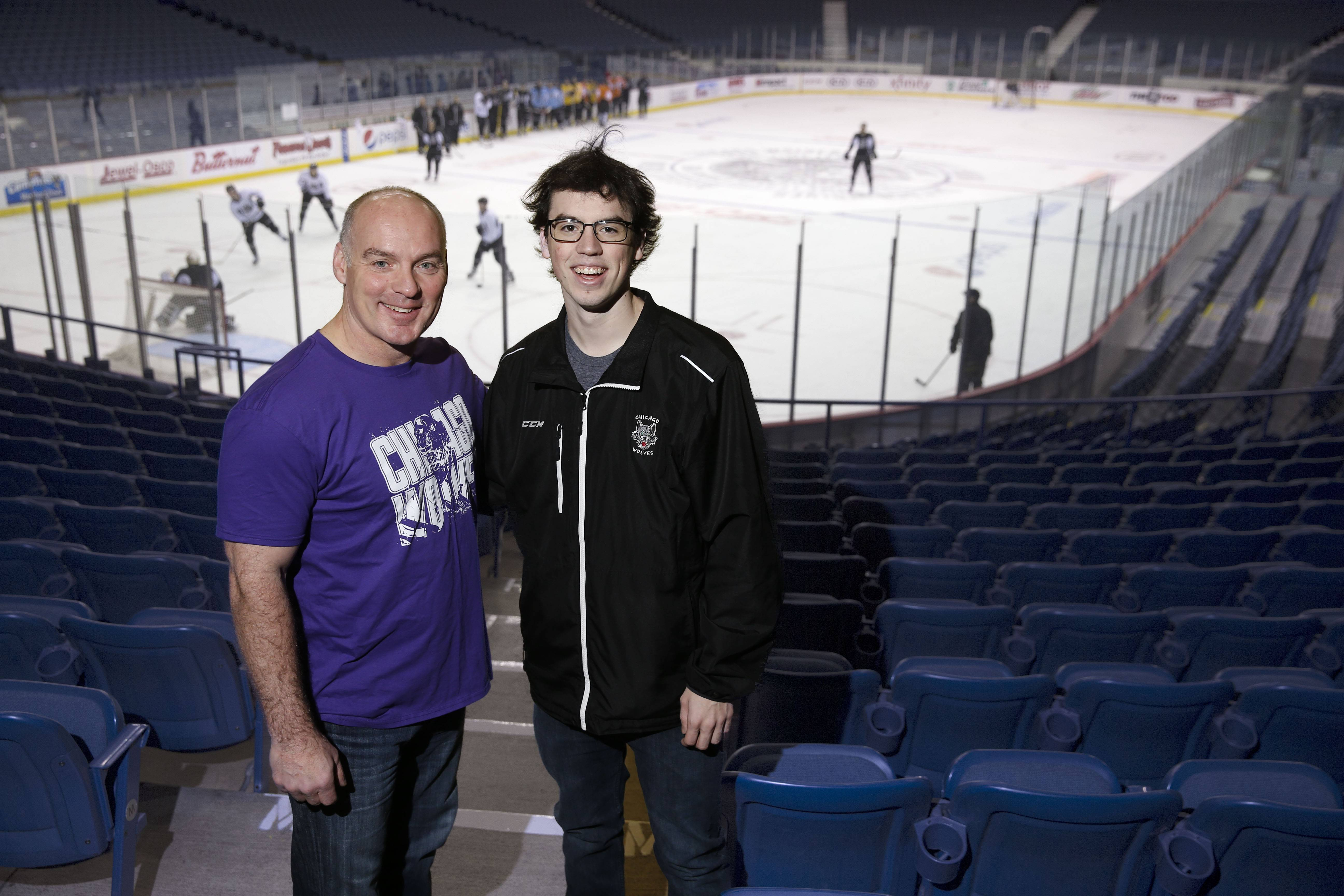 Wolves general manager Wendell Young, shown here with his son, Matthew, wears a commemorative T-shirt that will be given away to the first 2,500 fans at Saturday's game at Allstate Arena. It also will be sold to raise funds and awareness for the Epilepsy Foundation of Greater Chicago.