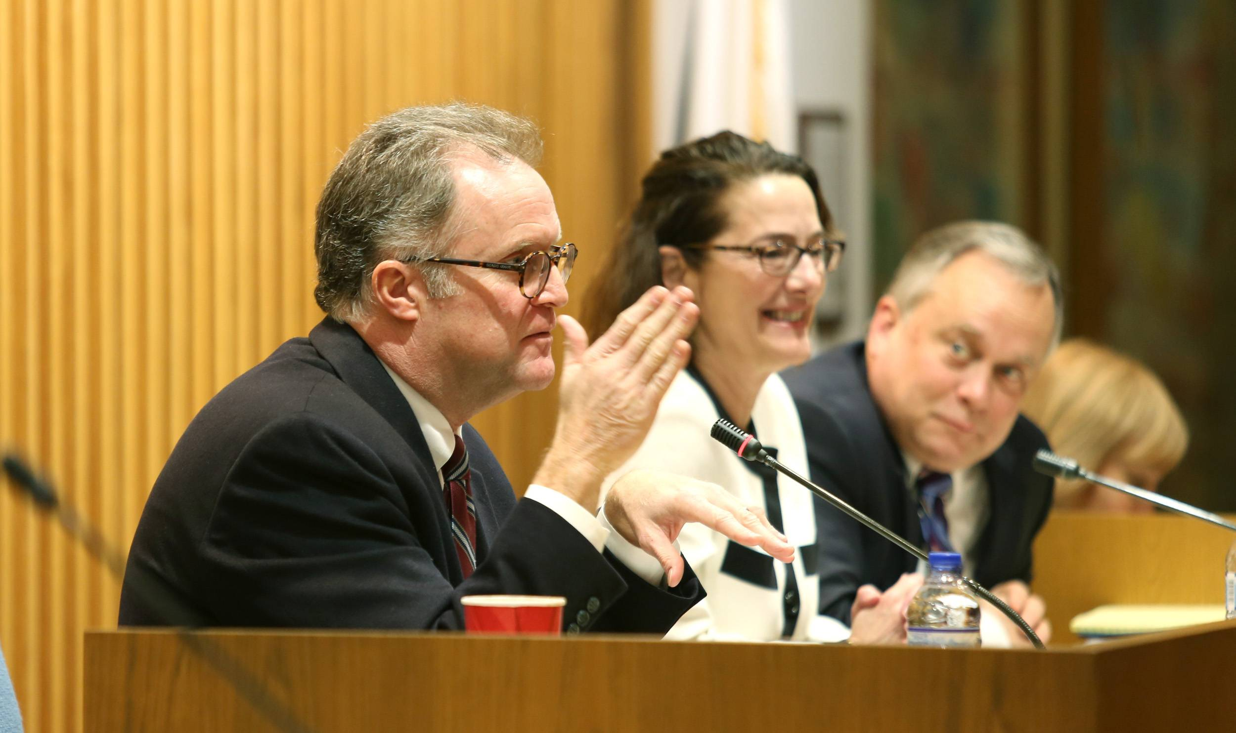 DuPage County Board Chairman Dan Cronin, left, hosts a forum for finalists in the application process to fill the county board vacancy in District 4. Amy Grant, center, and Grant Eckhoff also posed questions to the finalists.