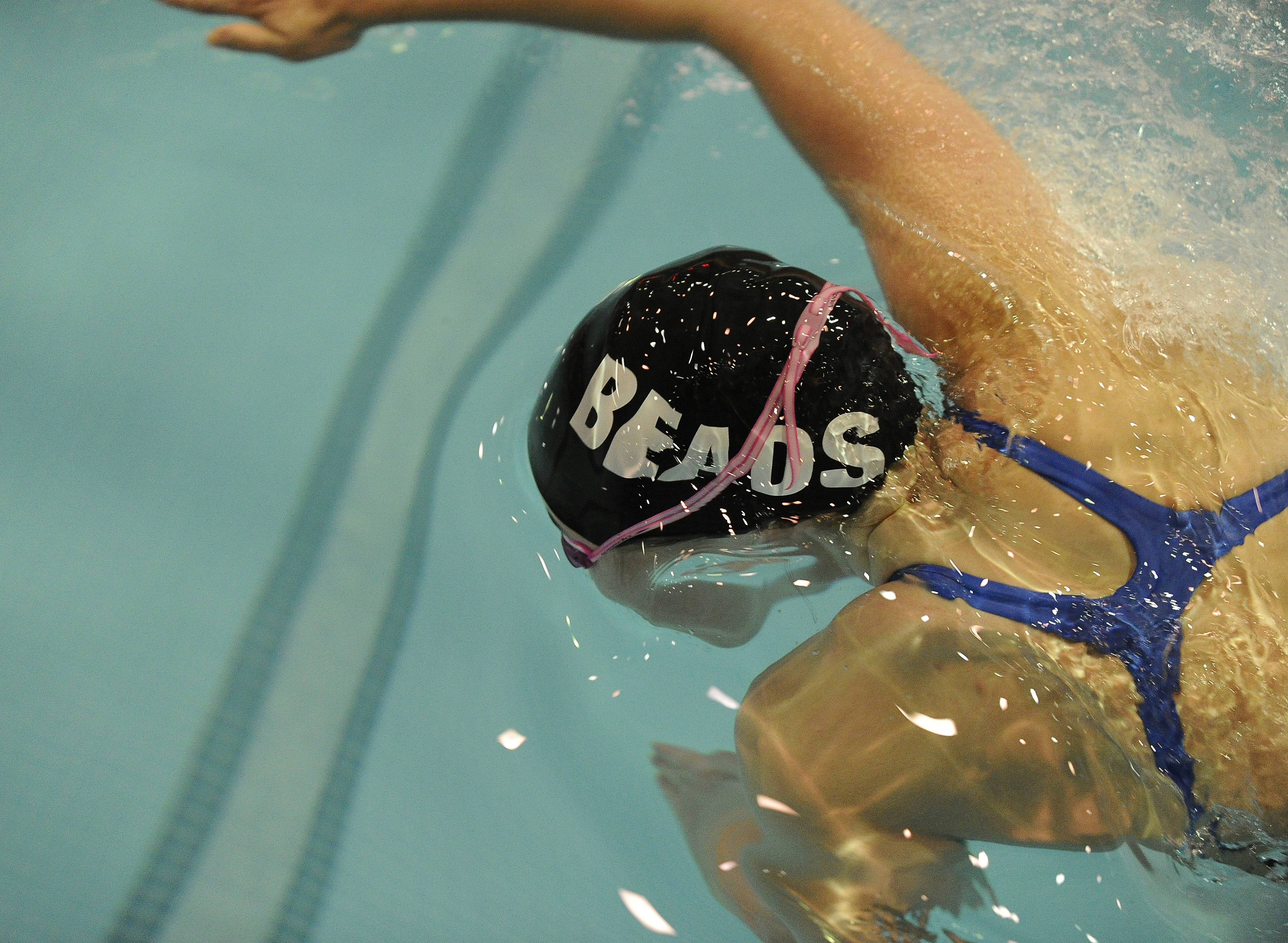 Rosary Erin Hart powers ahead in the 50-yard Freestyle in the state swimming finals in Evanston on Saturday.