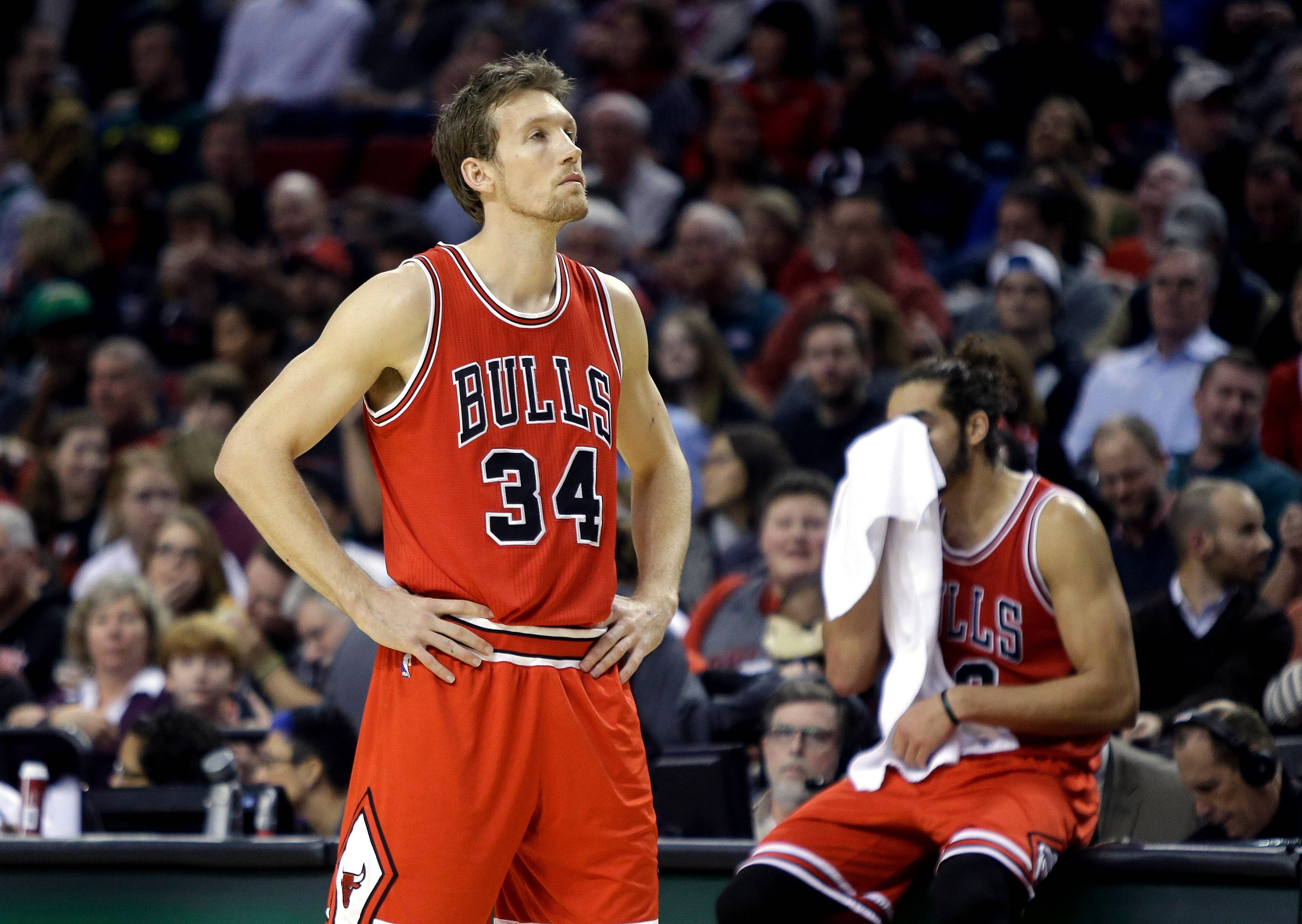 The Bulls' Mike Dunleavy, left, center Joakim Noah wait before referees ruled that Dunleavy had committed a flagrant foul during the second half Friday night in a 105-87 loss to the Trail Blazers in Portland, Ore.