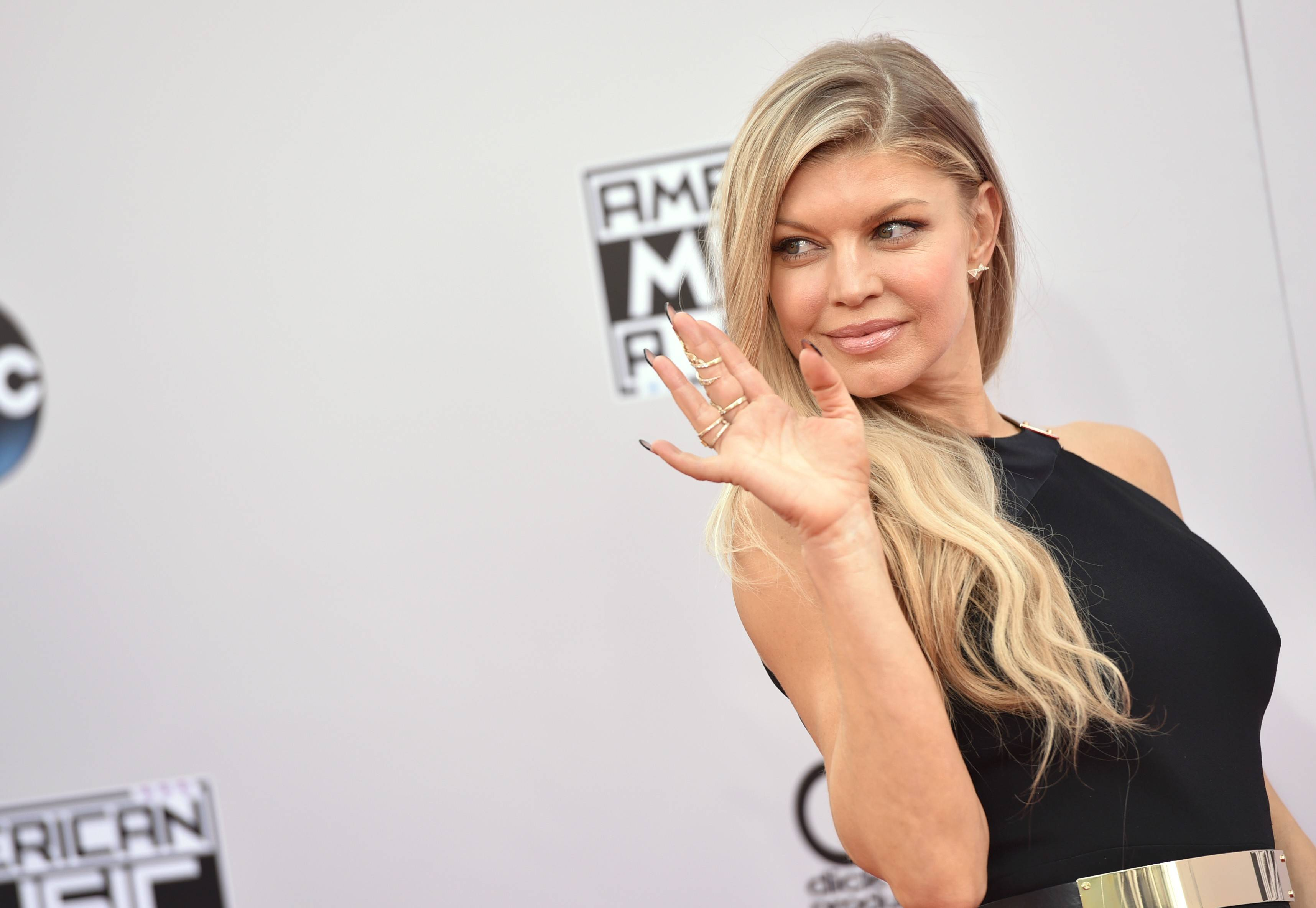 Fergie arrives at the 42nd annual American Music Awards at Nokia Theatre L.A. Live on Sunday, Nov. 23, 2014, in Los Angeles.