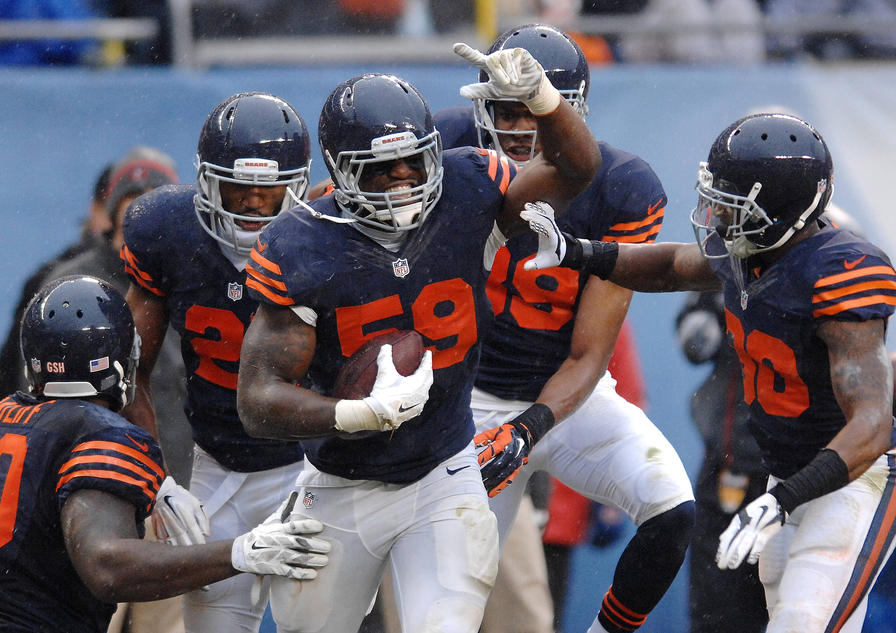 Chicago Bears inside linebacker Christian Jones (59) celebrates with his teammates after a fumble recovery during Sunday's game at Soldier Field in Chicago.