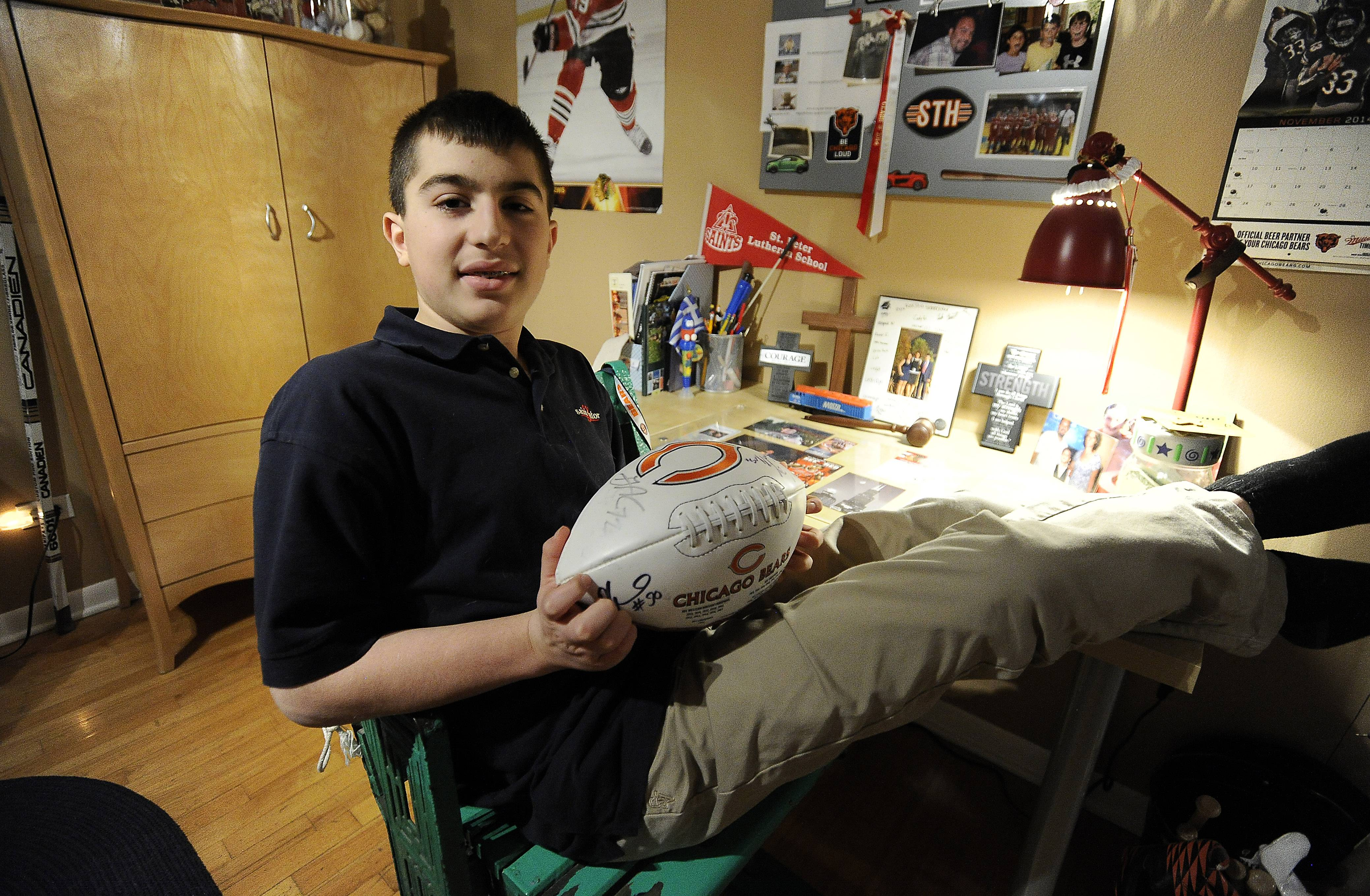 A huge fan of the Bears and every other Chicago team (except the Cubs), Daniel Isufi of Arlington Heights shows off some of his sports memorabilia. The Bears and Make-A-Wish are treating the 14-year-old to today's Bears game at Soldier Field.