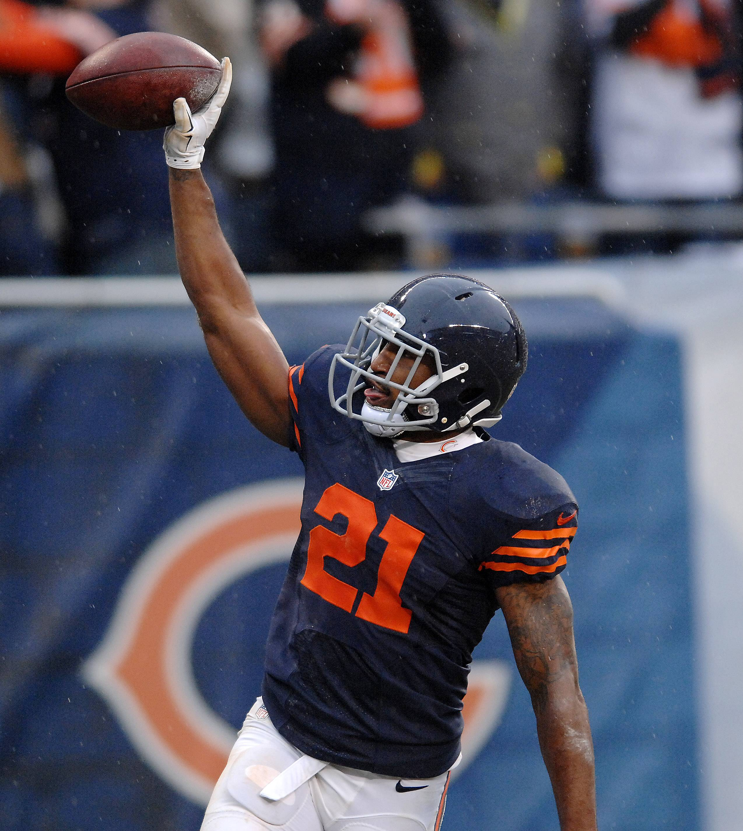 Bears strong safety Ryan Mundy (21) celebrates his interception during Sunday's game at Soldier Field.