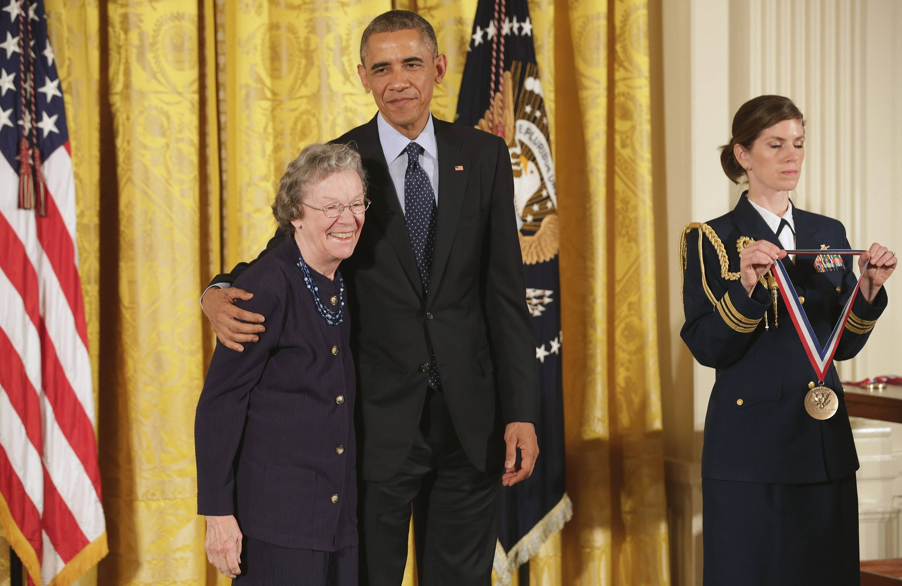 President Barack Obama, center, prepares to present Edith Flanigen, at left, a retired chemist with UOP LLC., with the National Medal of Technology and Innovation in the East Room of the White House on Nov. 20 in Washington, DC.