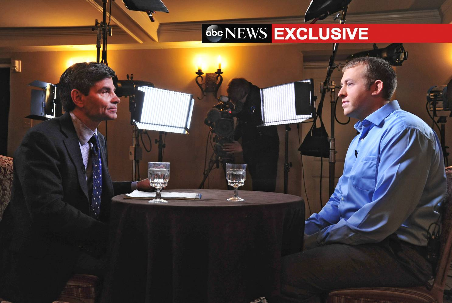 In this photo provided by ABC News, ABC News' chief anchor George Stephanopoulos, left, interviews Ferguson, MO., police officer Darren Wilson, Tuesday, Nov. 25, 2014 in Missouri. The interview will air during ABC News programs and platforms on Nov. 25 and 26. (AP Photo/ABC News, Kevin Lowder)