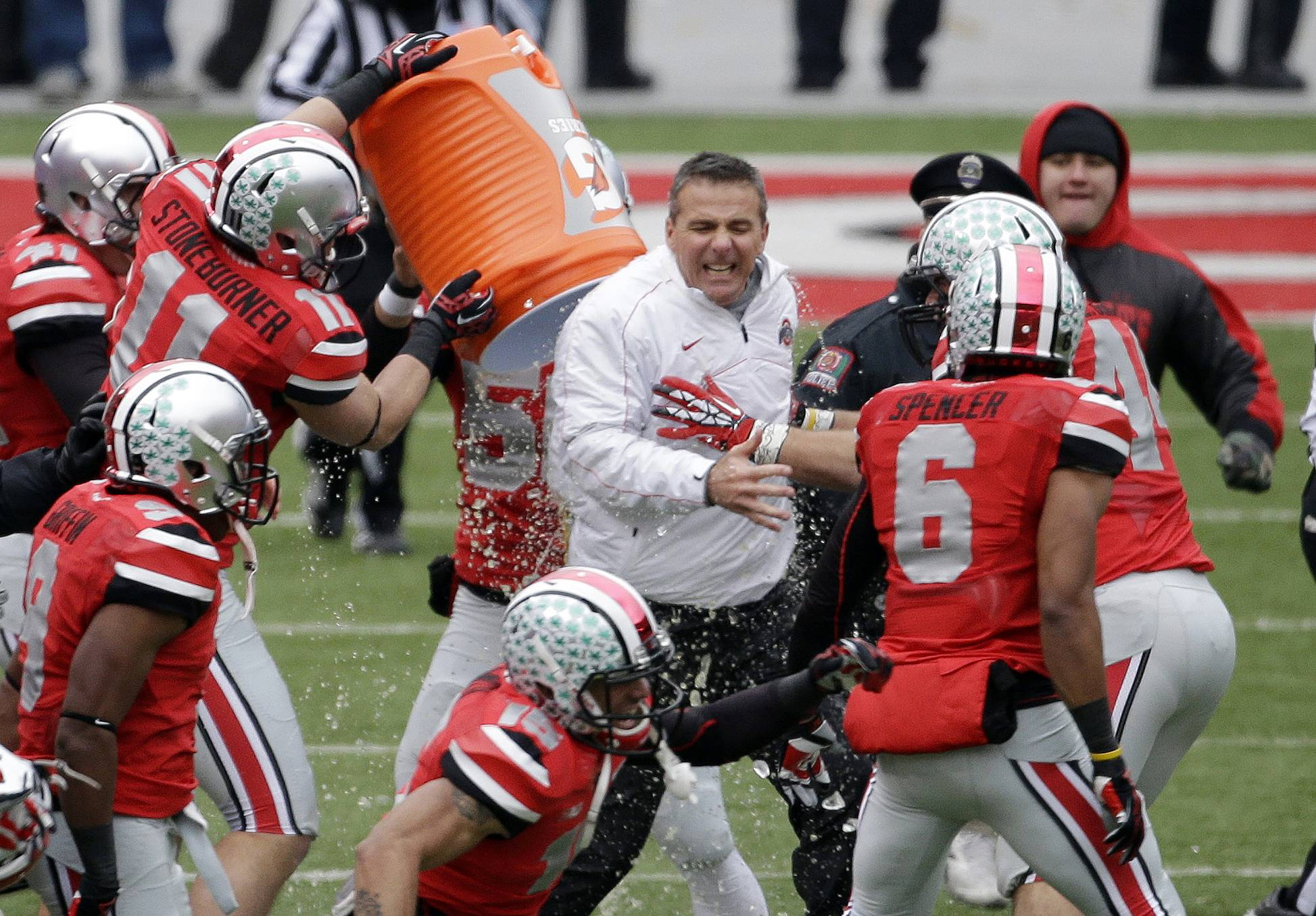 Ohio State head coach Urban Meyer gets doused by senior wide receiver Jake Stoneburner after a win over Michigan in Columbus, Ohio. For the second year in a row, not only do the Buckeyes have the Wolverines to deal with, but also the Big Ten title game looming a week later.