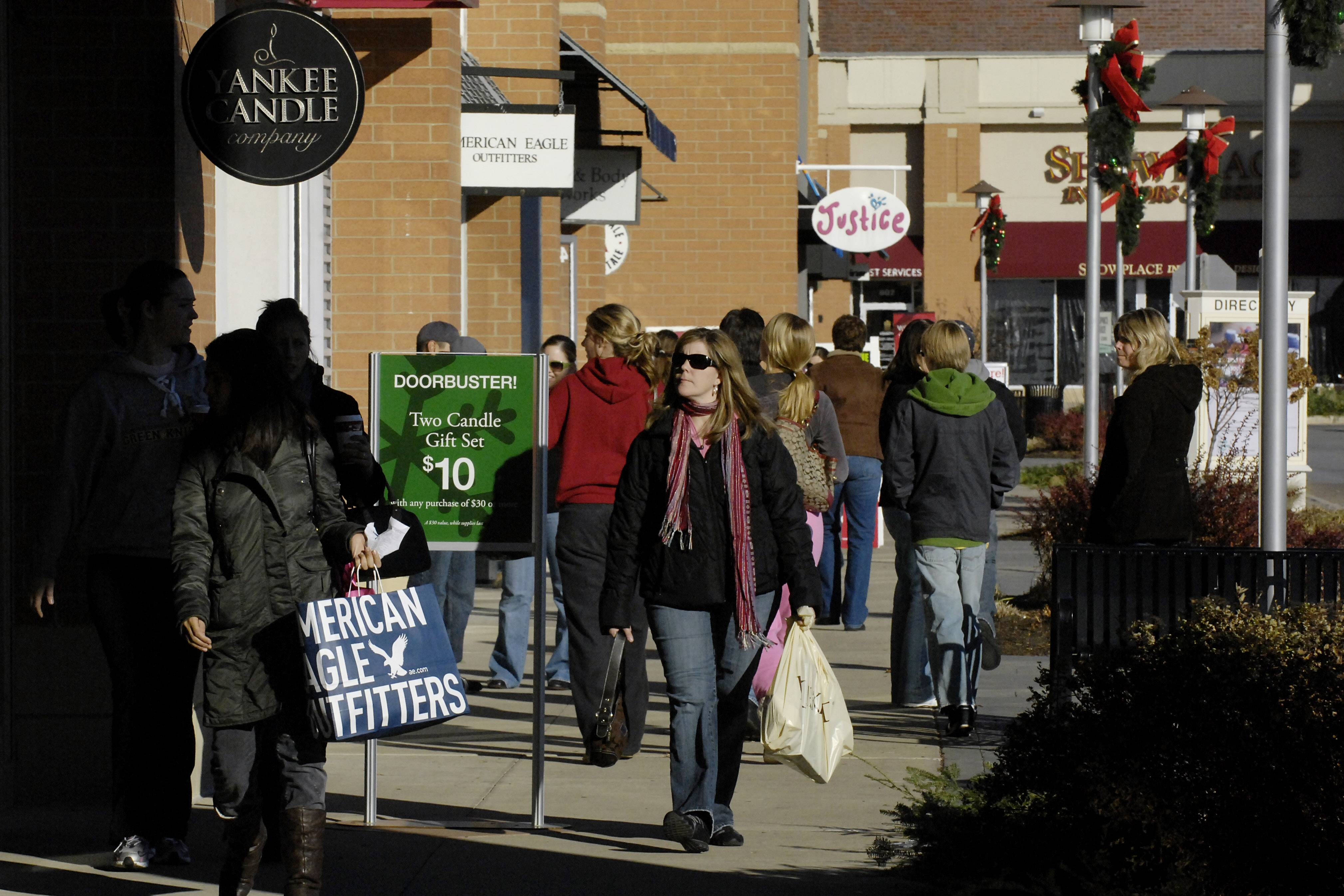 Shoppers hit Geneva Commons the morning after Thanksgiving in search of bargains. Several stores at the outdoor mall will open on Thanksgiving Day this year, including The Gap at 4 p.m. Thursday.