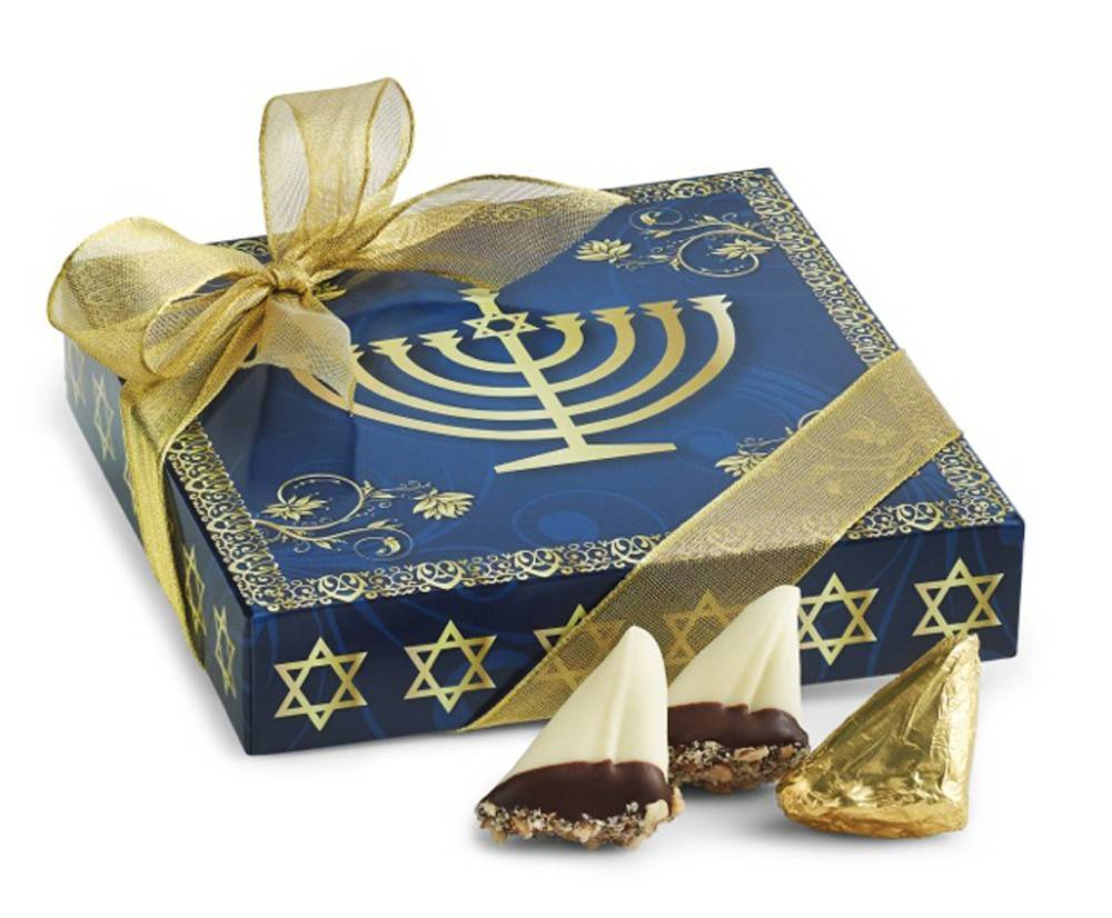 This undated image provided by Harbor Sweets shows the company's �Chanukah Box� of chocolates decorated with a menorah. Harbor Sweets, a small New England handcrafted chocolate company, created the box in response to demand among customers who wanted to give chocolates as a holiday gift while acknowledging friends and clients who don't celebrate Christmas. It's one of a number of examples of products originally conceived of as Christmas gifts that have been rethemed for Hanukkah.