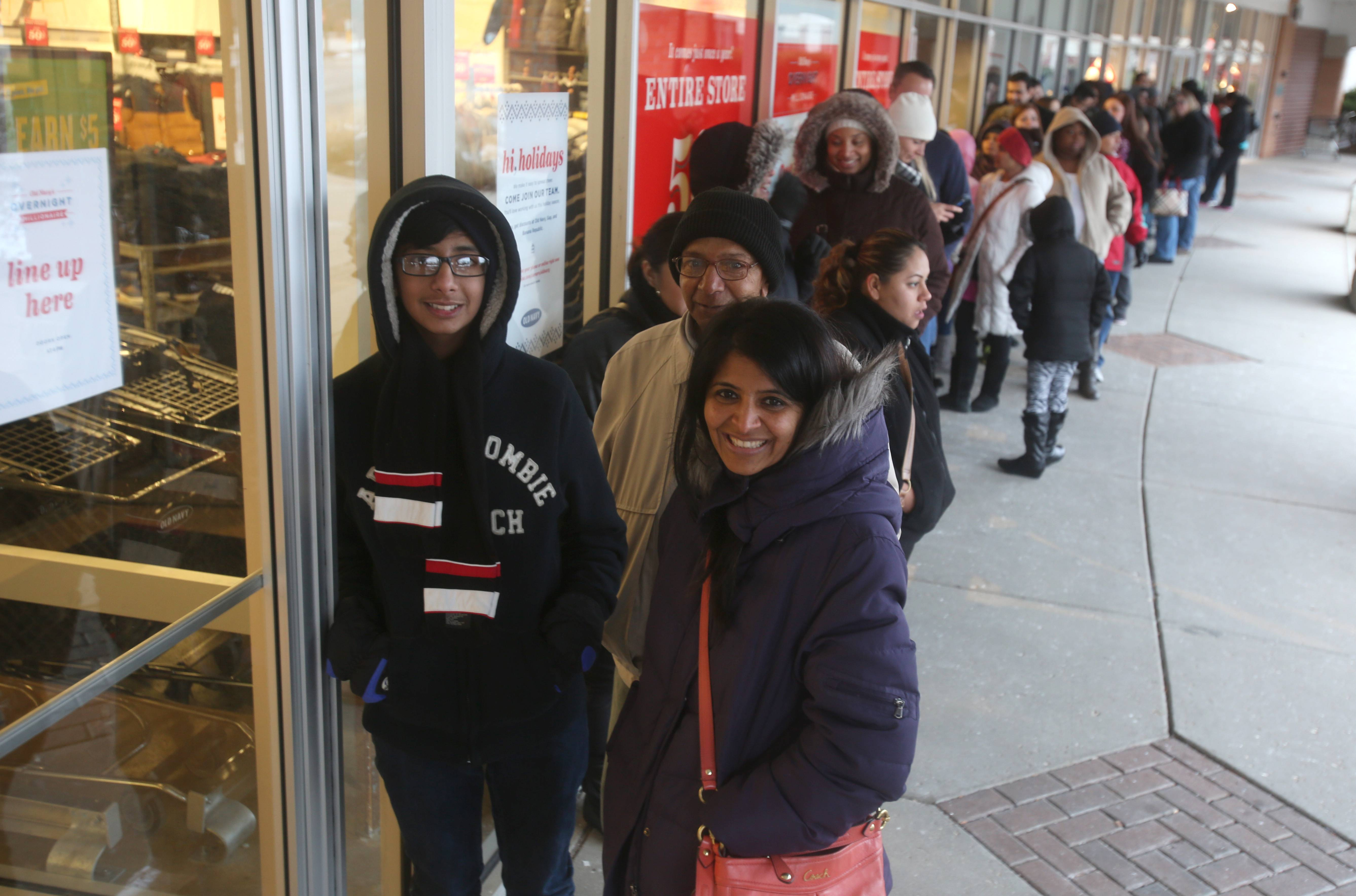 Prafula Patel of Hoffman Estates and her family are first in line Thanksgiving Day to get 50 percent off merchandise at the Old Navy Store in Schaumburg.