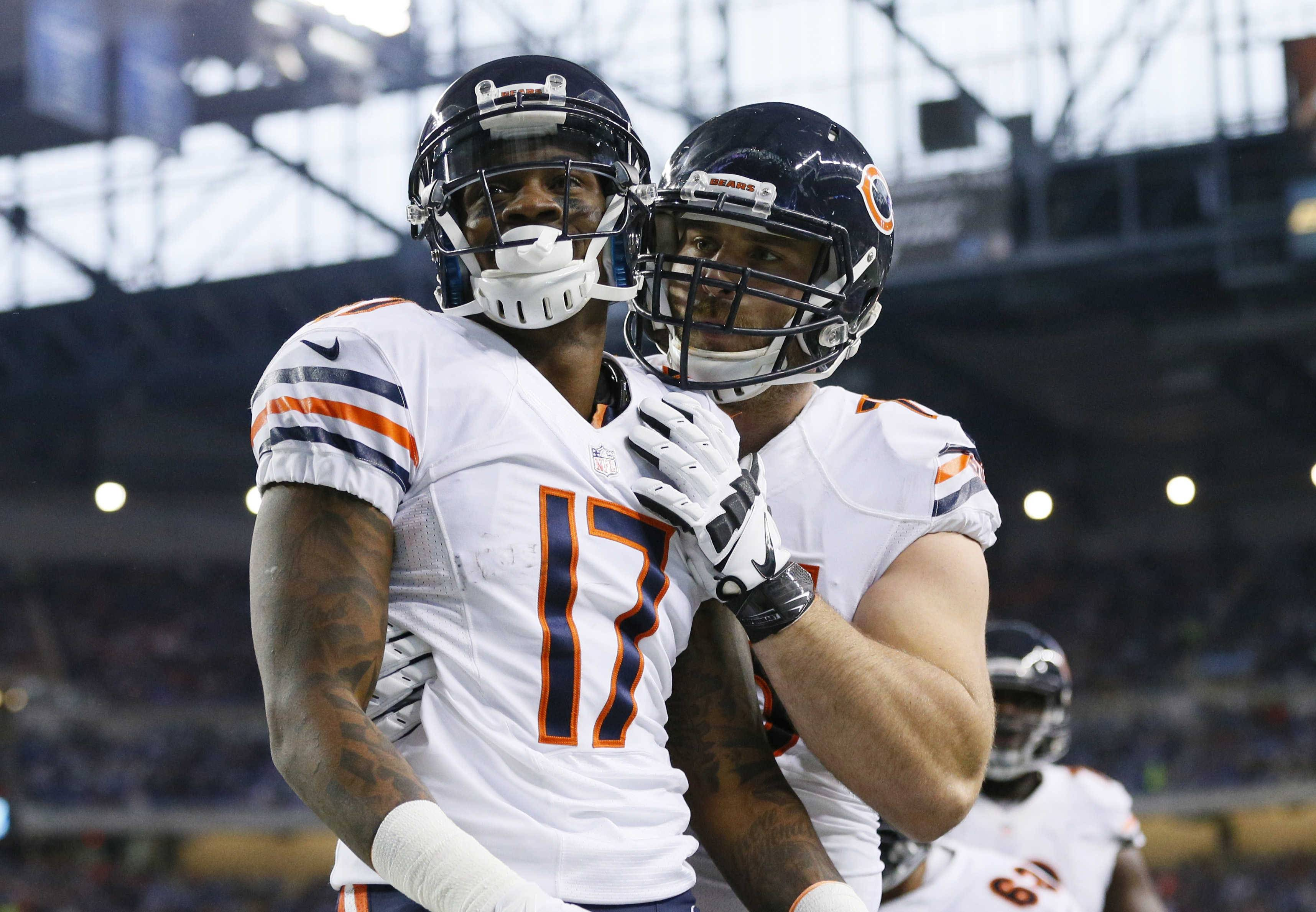 Chicago Bears wide receiver Alshon Jeffery is congratulated after his 6-yard touchdown reception during the first half of an NFL football game against the Detroit Lions in Detroit, Thursday, Nov. 27, 2014.