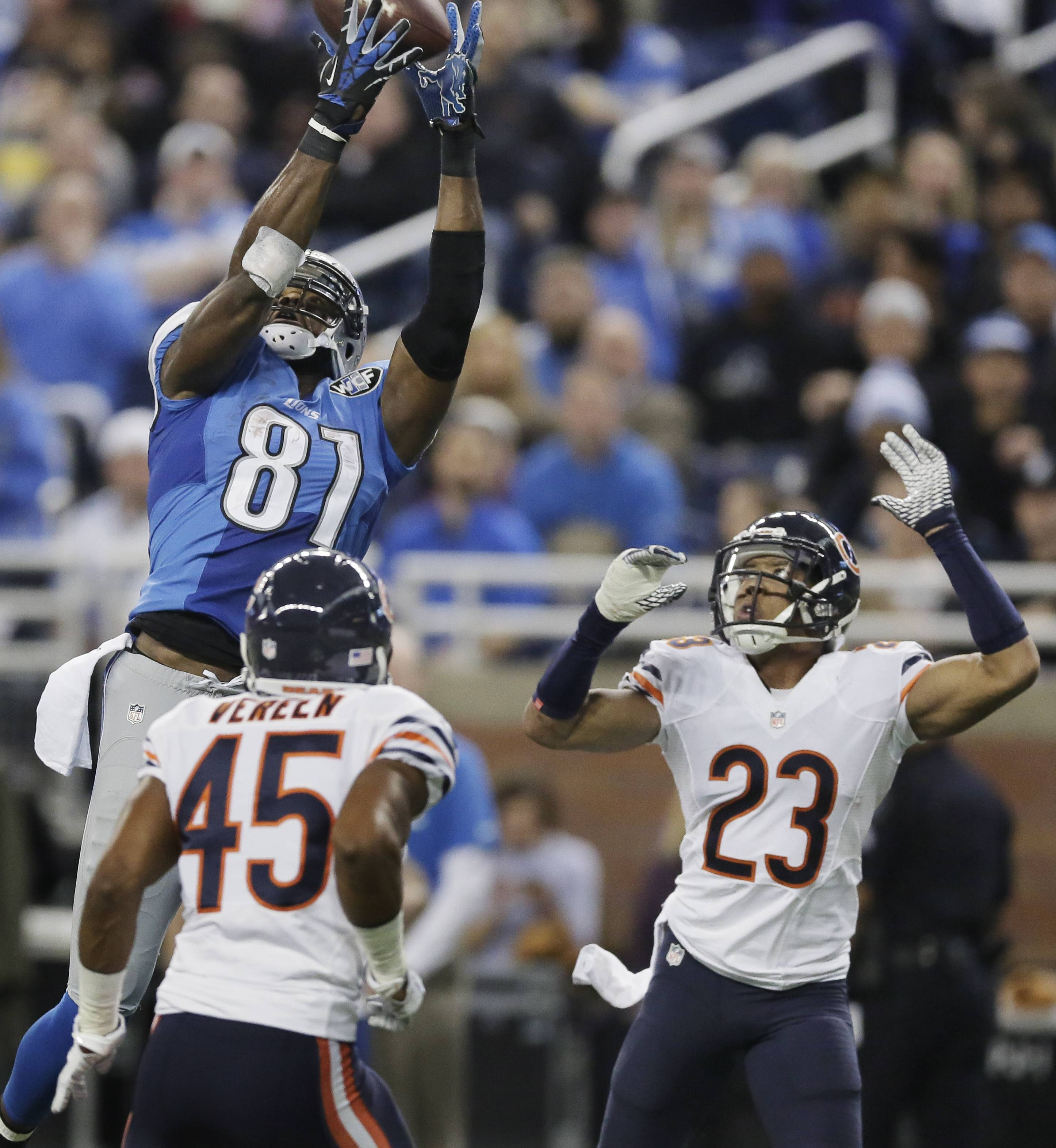 Lions wide receiver Calvin Johnson (81), defended by Bears cornerback Kyle Fuller (23), makes a 25-yard reception for a touchdown during Thursday's first half in Detroit.