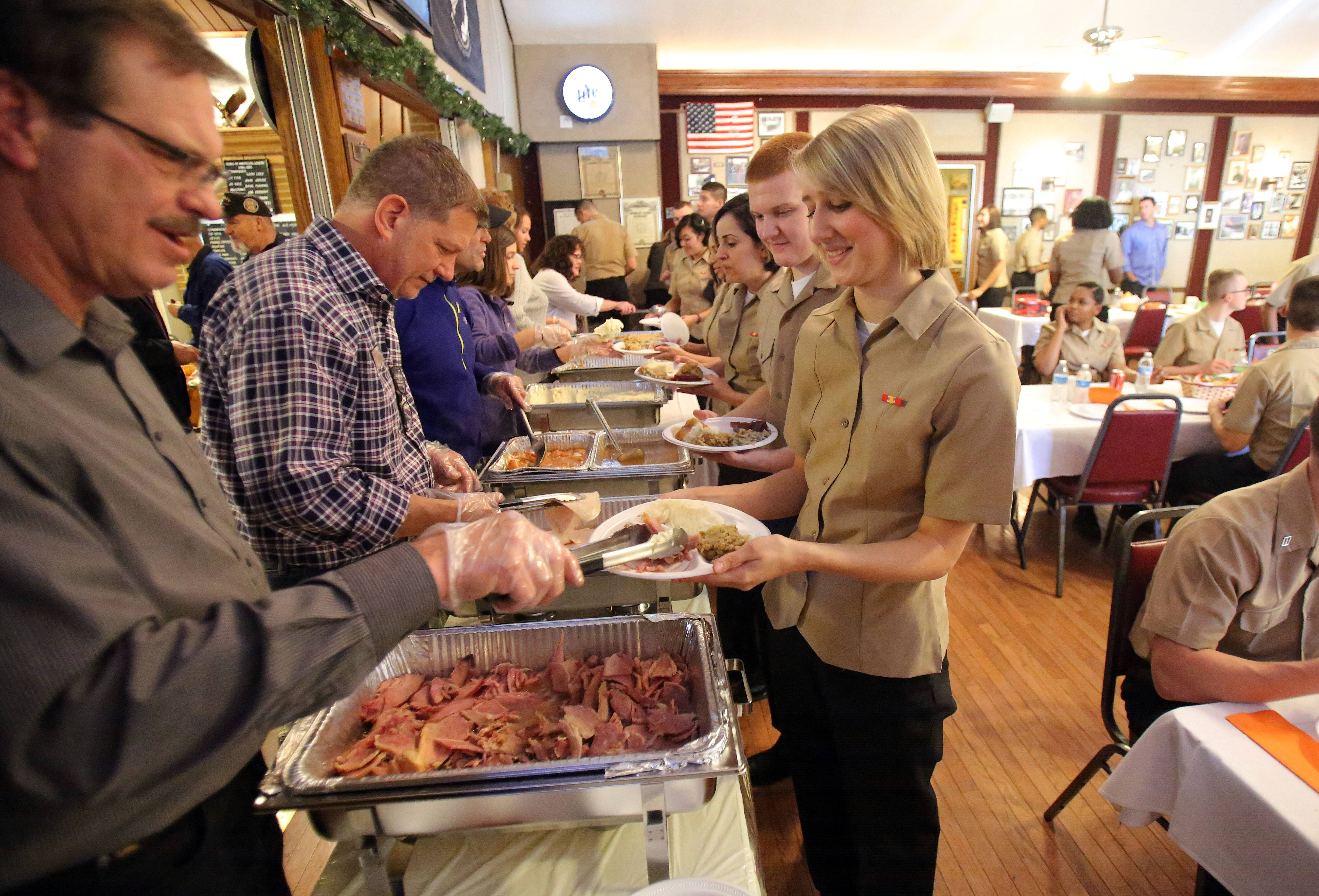 More than 100 recruits from the Great Lakes Naval Station celebrated Thanksgiving at the American Legion hall in Arlington Heights.