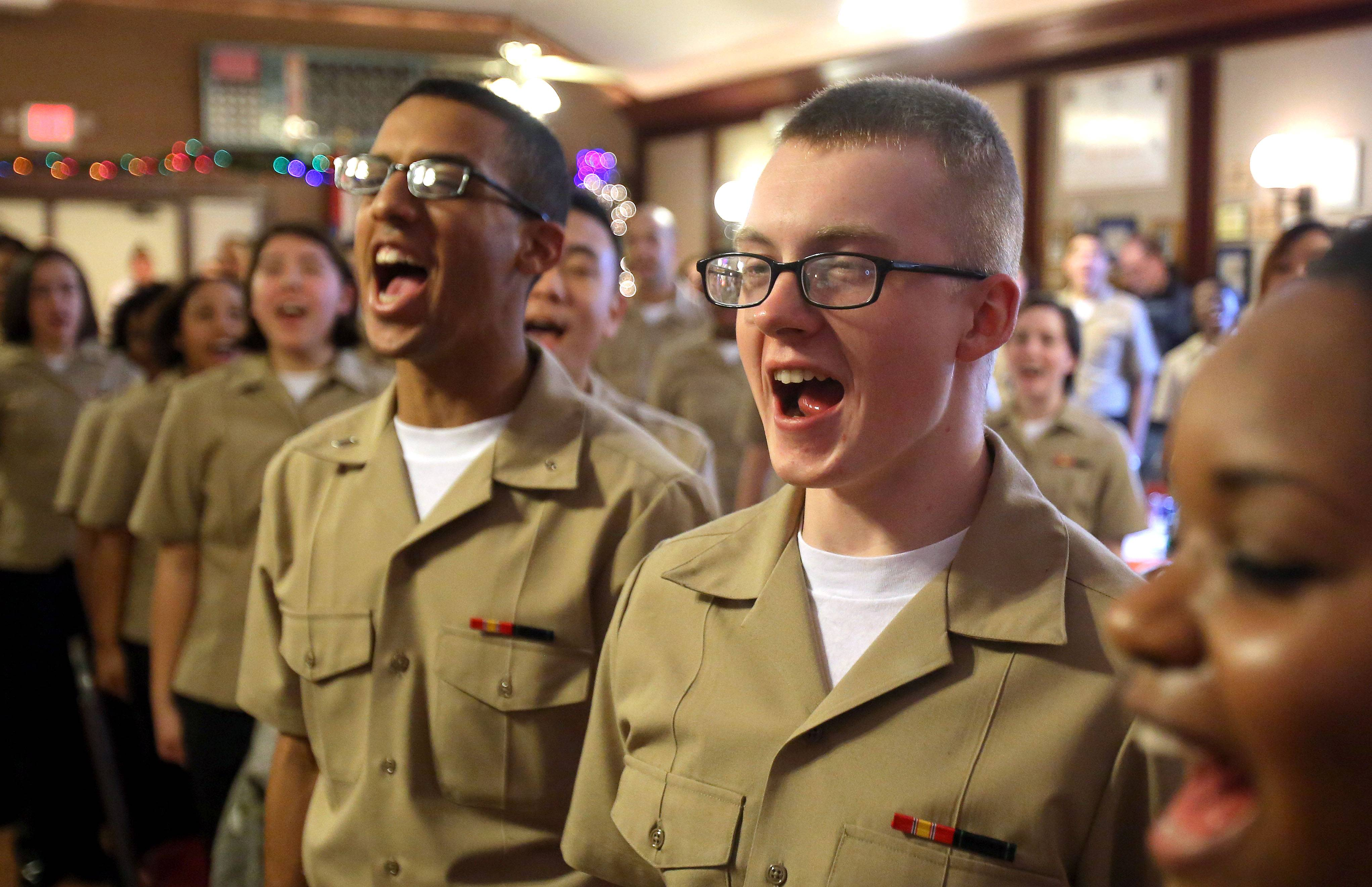 "U.S. Navy recruits Christopher Greenwade, left, and Jerin Jimerson sing ""Anchors Aweigh"" during a Thanksgiving celebration at American Legion Post No. 208 in Arlington Heights."