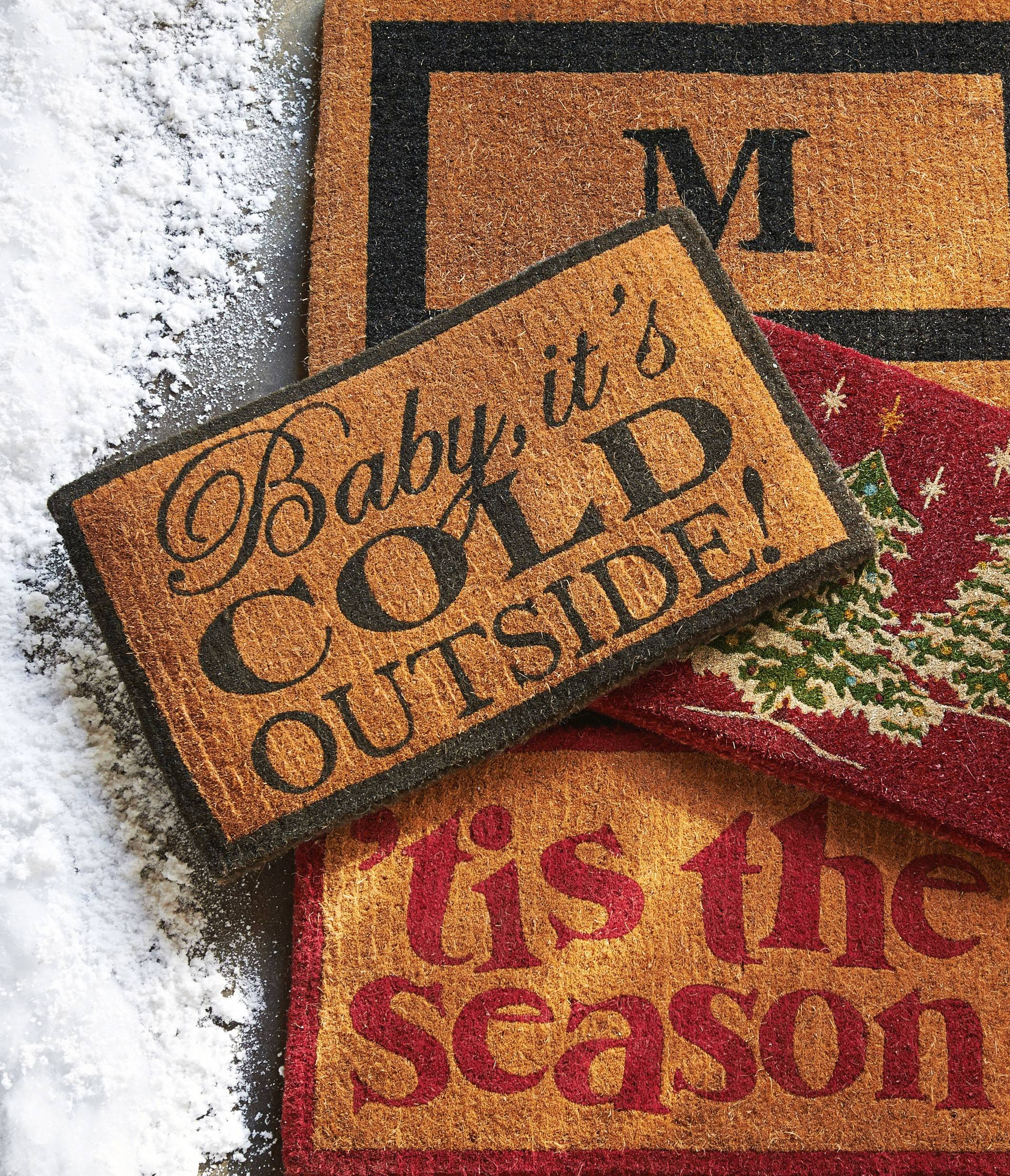 In this photo provided by Pottery Barn, vintage vibes run strong again this Christmas in these doormats with old style script to welcome guests.