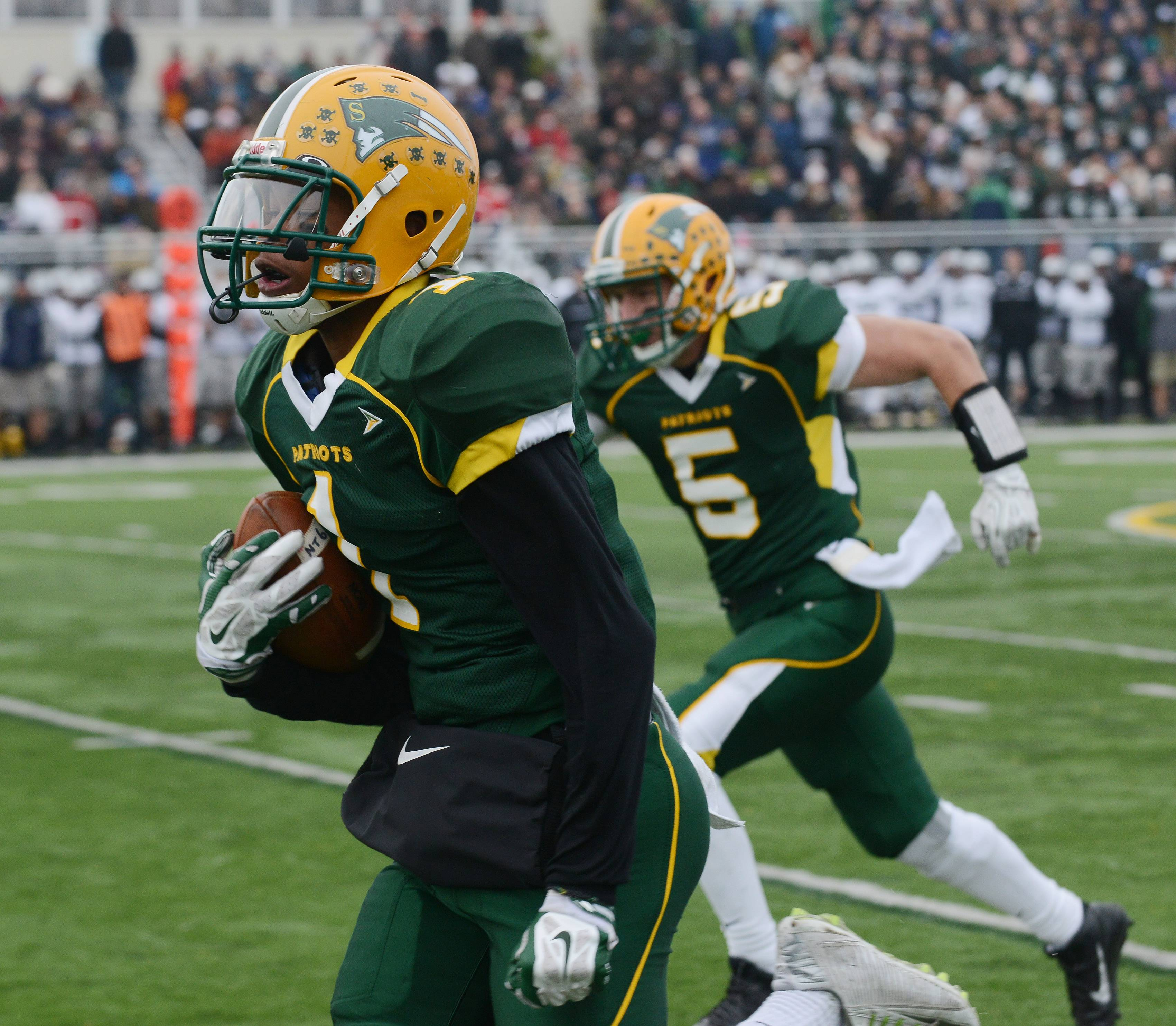 Stevenson's Jeremy Webb carries celebrates a touchdown against New Trier in Class 8A state quarterfinal play in Lincolnshire. The Patriots meet Homewood-Flossmoor for the state championship at 7 p.m. Saturday in Champaign.