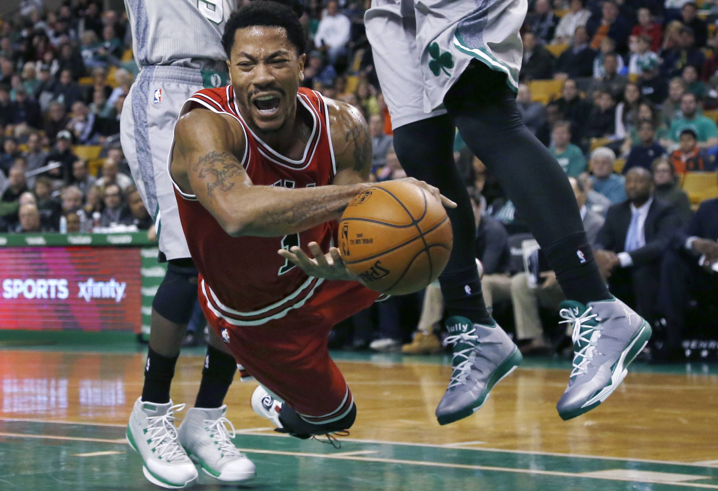 Chicago Bulls guard Derrick Rose falls after being tripped while driving against the Boston Celtics in the first half of a basketball game in Boston, Friday, Nov. 28, 2014. (AP Photo/Elise Amendola)