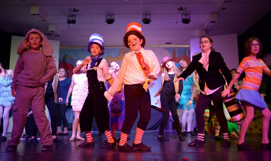 "Jayd Steinke, center, performs the opening number of ""Seussical Jr."" with castmates in the production by Marquee Youth Stage in St. Charles. Joining her, from left, are Andrew Perez, 10, of Geneva, Elyse Jens, 10, of St. Charles, Kathryn Dybas, 12, of St. Charles, and Ava Nunez, 11, of West Chicago."