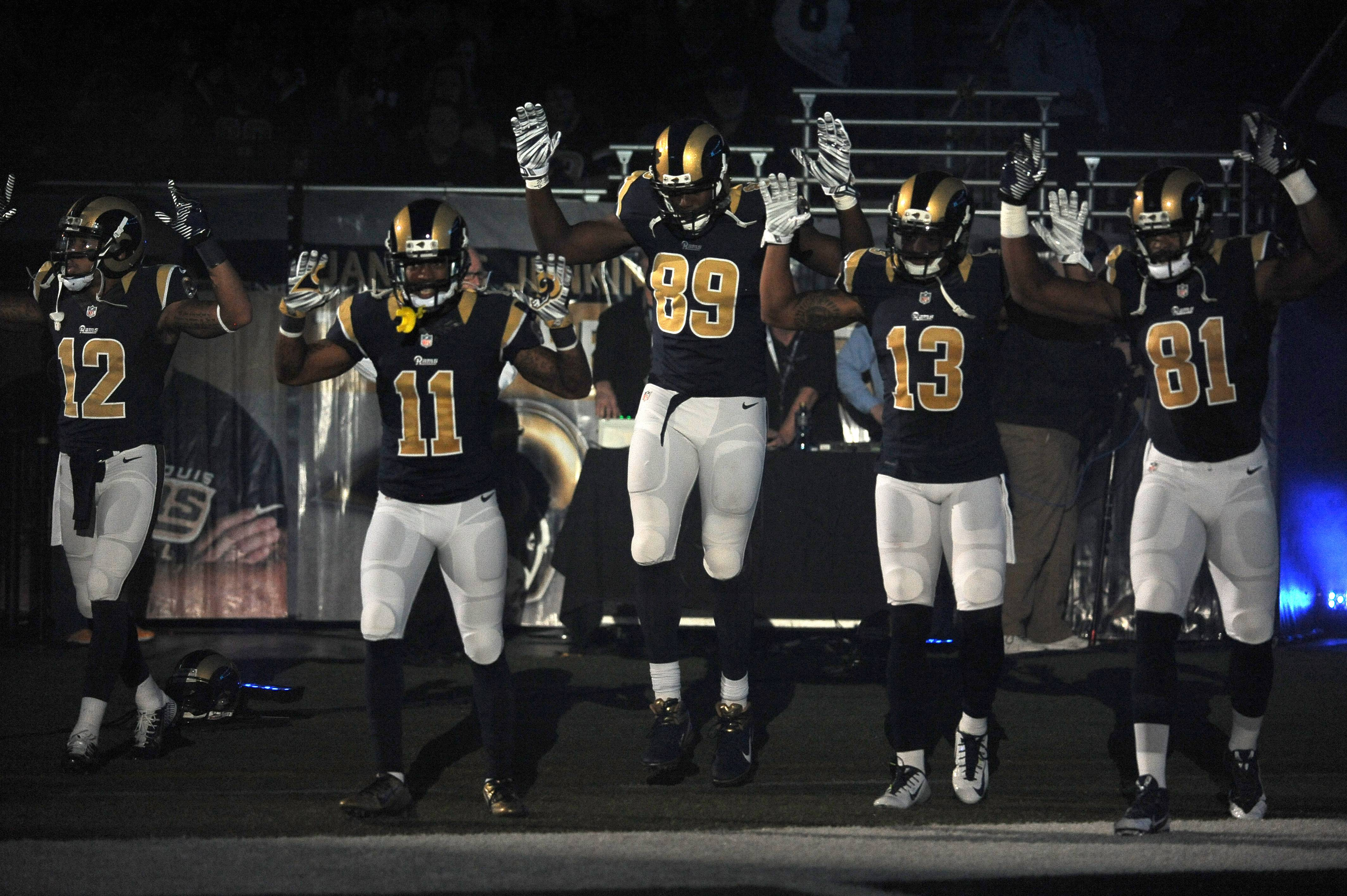 Rams players raise arms in apparent show of solidarity with Ferguson protesters