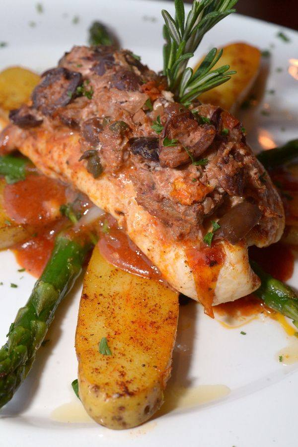 Mediterranean Mahi-mahi served with potatoes and asparagus is on the dinner menu at Top Table in St. Charles.