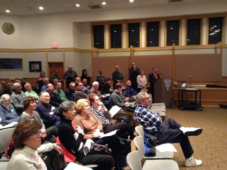 "Dozens of Buffalo Grove residents attended Monday night's village board meeting to hear the latest on a proposal calling for a huge ""downtown"" development along Lake-Cook Road. Trustees postponed a decision on whether to seek voters' input through an April 7 referendum."