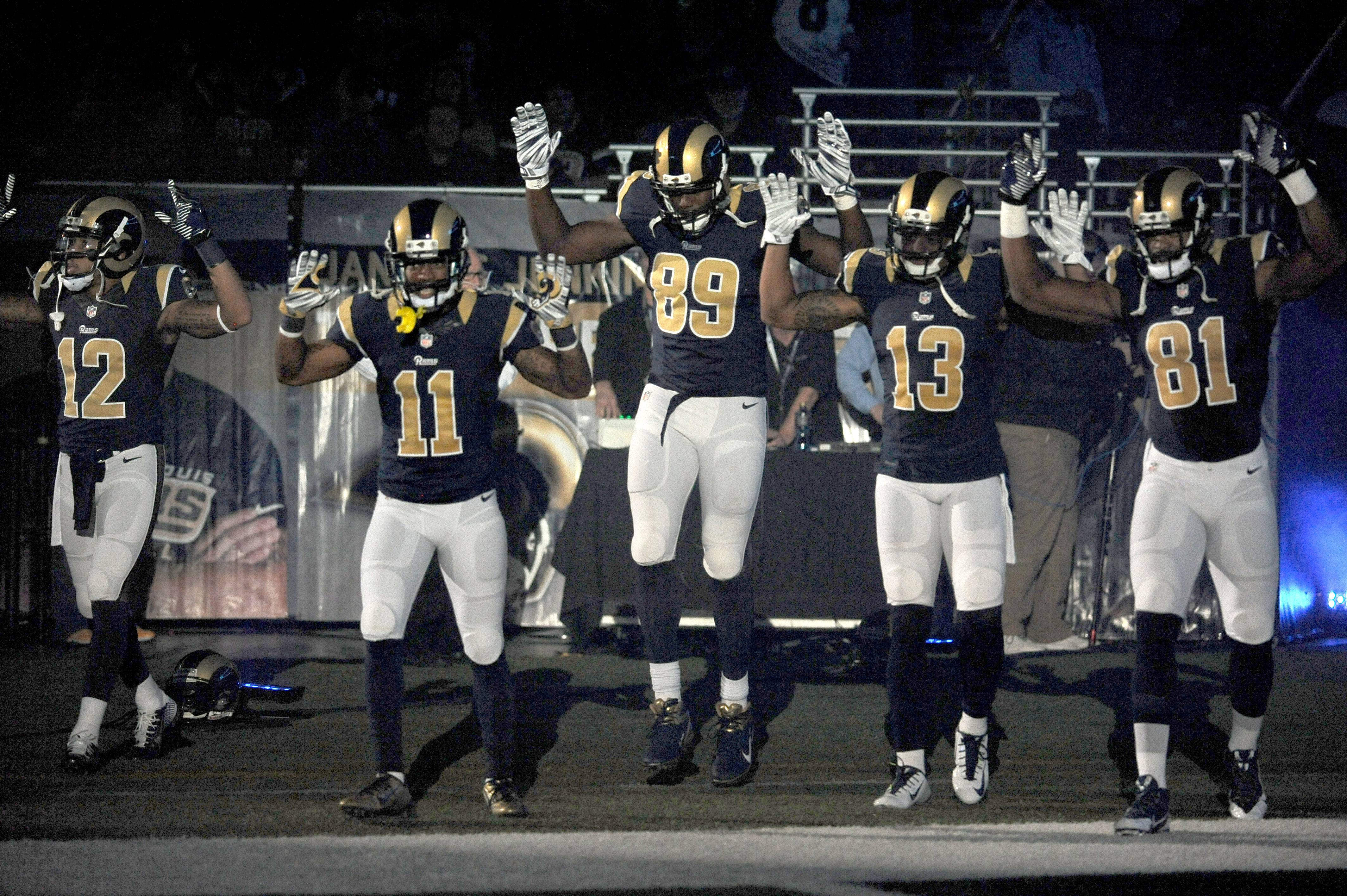 A St. Louis Rams official and a county police chief differed Monday about whether the team had apologized for the actions of five players who raised their hands during pregame festivities Sunday in a show of solidarity with Ferguson protesters.