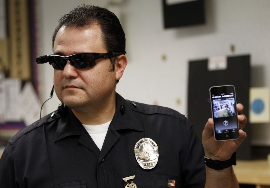 Los Angeles Police Sgt. Daniel Gomez demonstrates a video feed from his camera into his cellphone during a on-body camera demonstration.