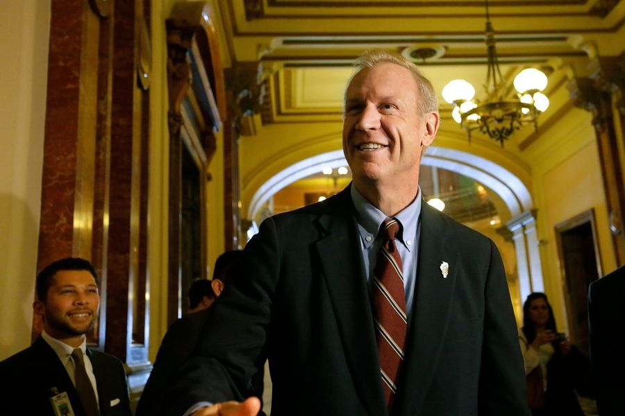 Republican Gov.-elect Bruce Rauner talks to reporters in the Illinois Capitol in November.