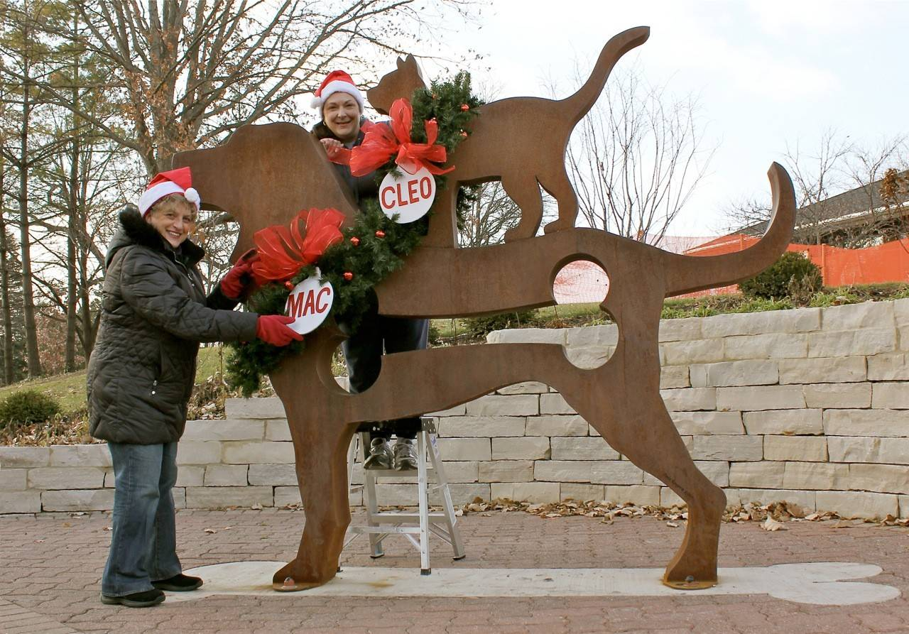 Naperville names dog, cat in humane society sculpture