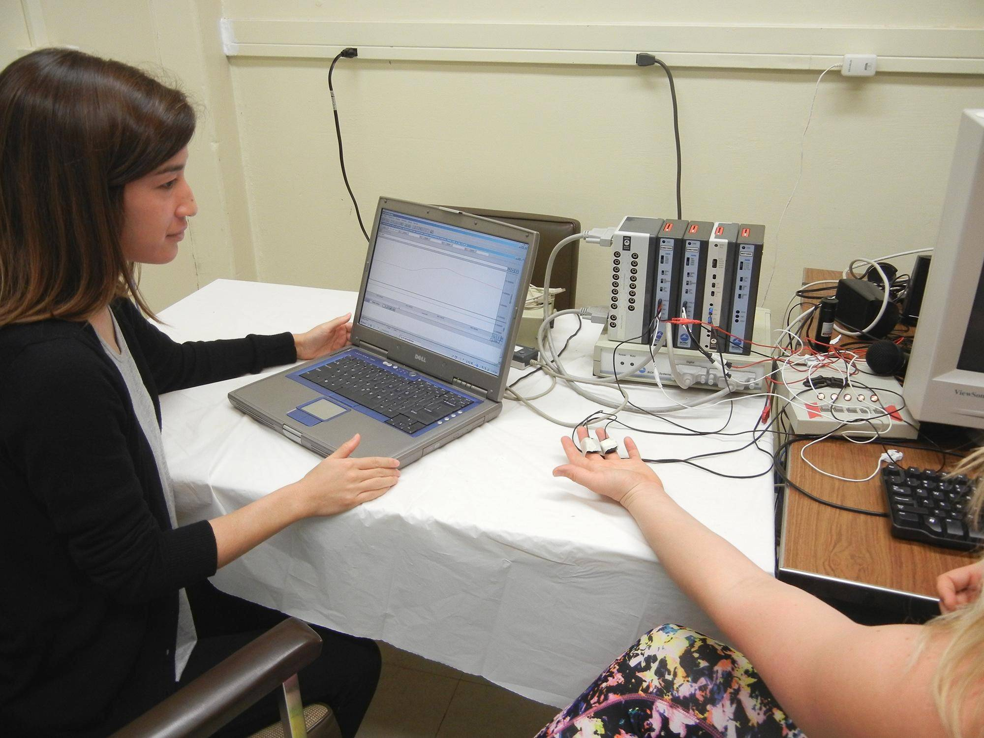 Ph.D student Miren Edelstein hooked up electrodes to volunteers' hands to verify that their aversion to certain sounds was real.