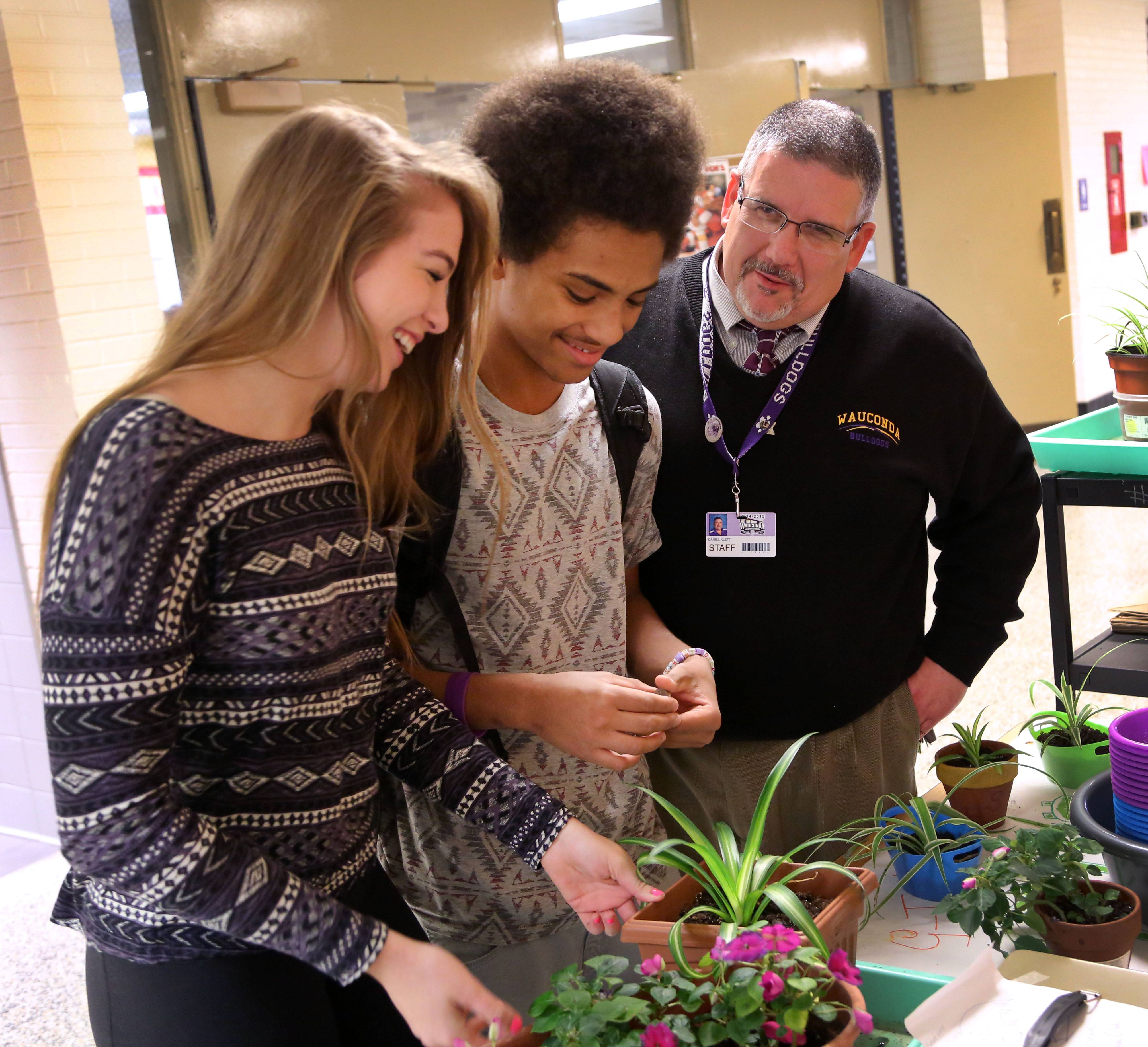 Wauconda High Principal Dan Klett, right, talks with Green Club members Alexandra Olson and Mackquon Jordan. They're both sophomores.