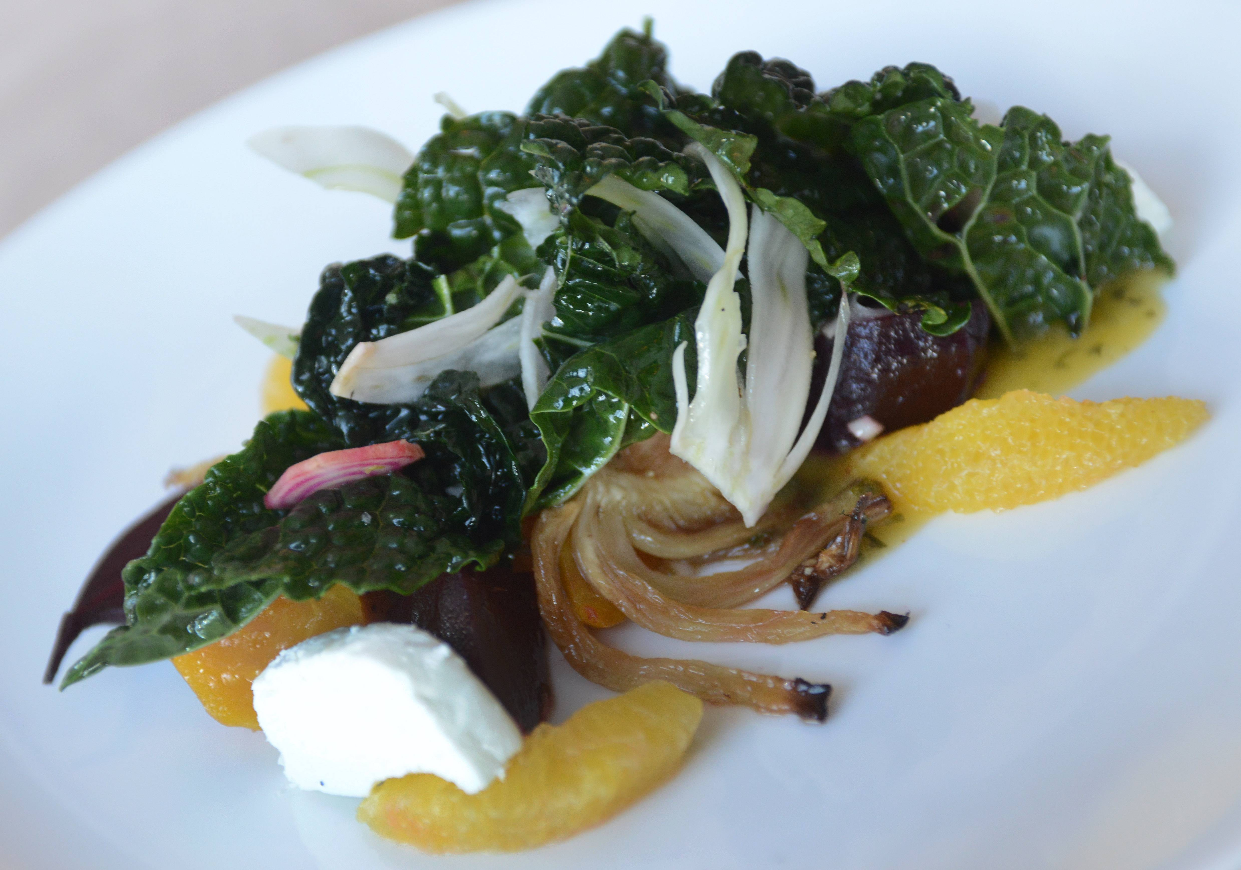 Roasted and chopped red and golden beets mixed with goat cheese, fennel, kale and blood orange in the beet salad at Grillhouse by David Burke in Schaumburg.