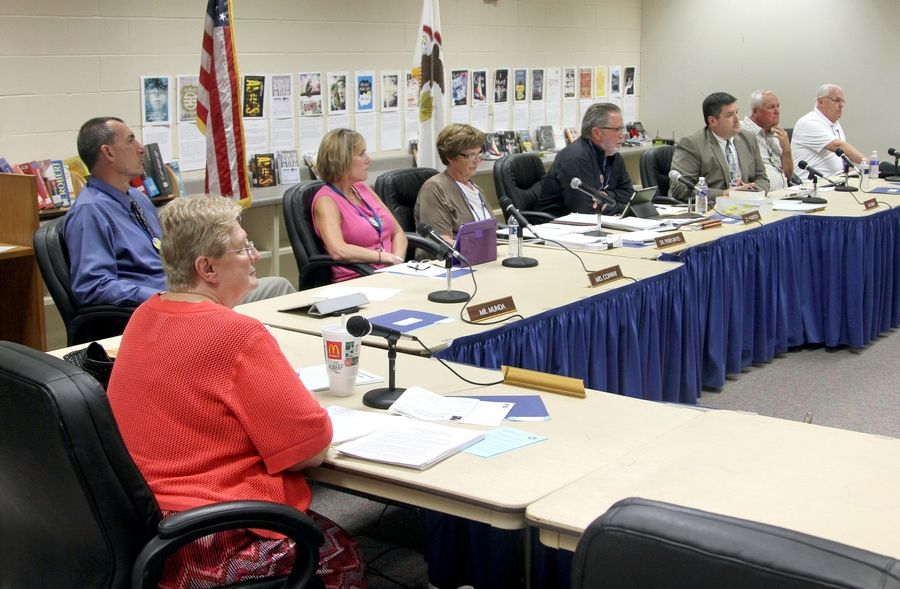 Warren Township High School District 121 board member Liz Biondi, bottom left, is apologizing for saying she doesn't want someone who's gay to be superintendent.