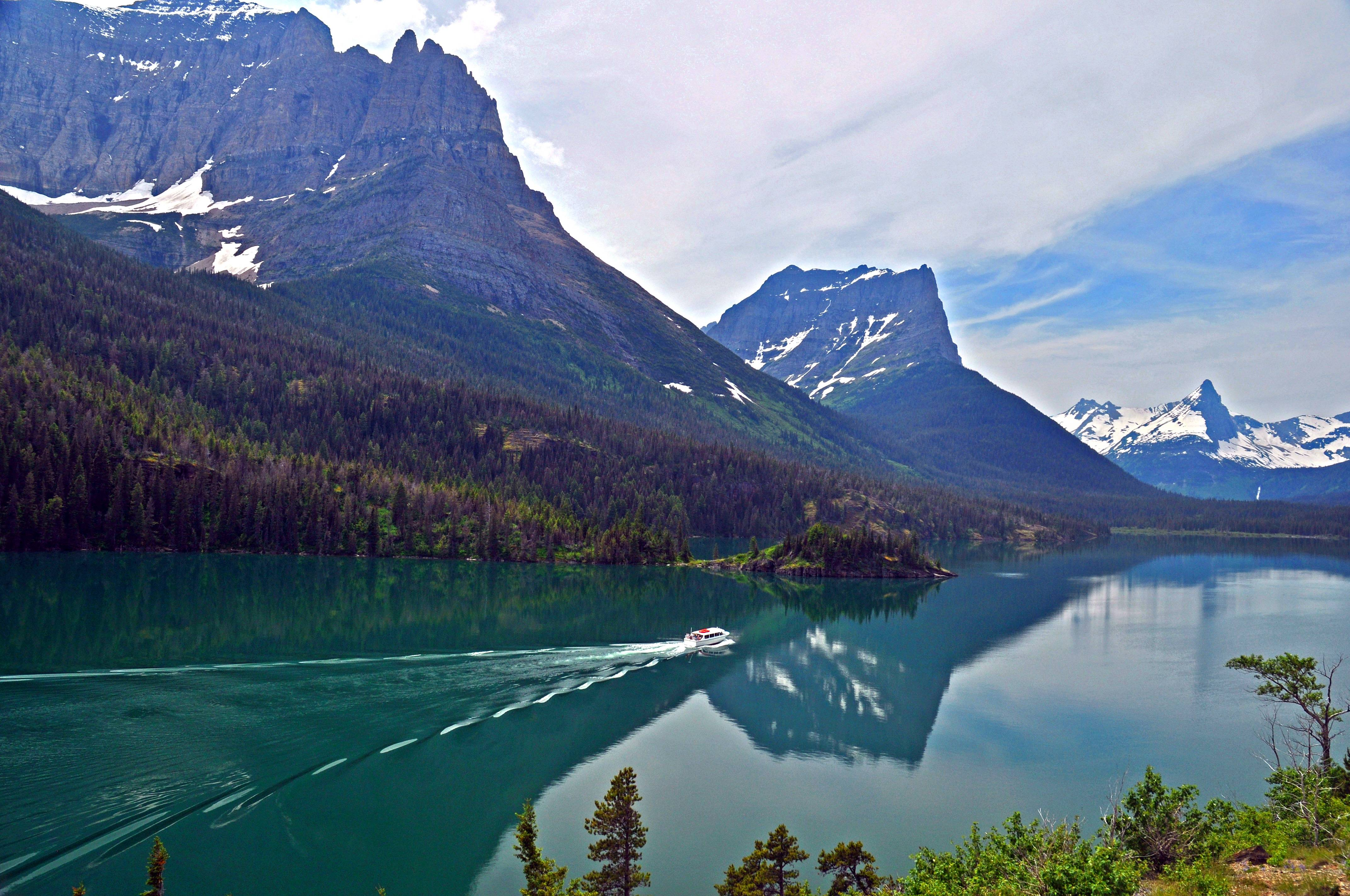 I took this photo during a summer trip to Glacier National Park in Montana, we watched a small tour boat cruise up beautiful St. Mary Lake toward the continental divide mountains as we continued on our hike to St. Mary Falls.