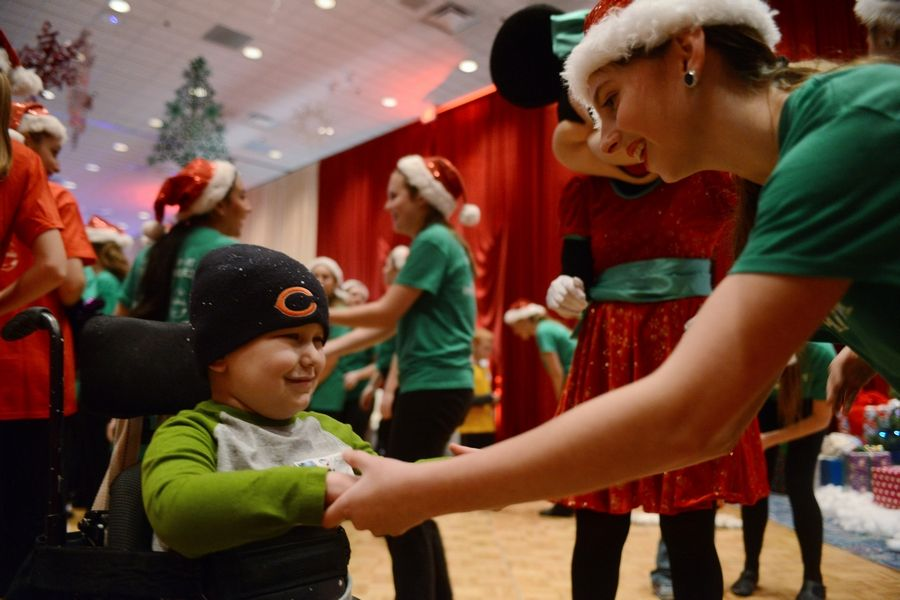 Riley Buckholz, 5, of Burlington, Illinois, dances with Mary Furlong of Barrington as part of Operation North Pole, an event for children with life-threatening illnesses.