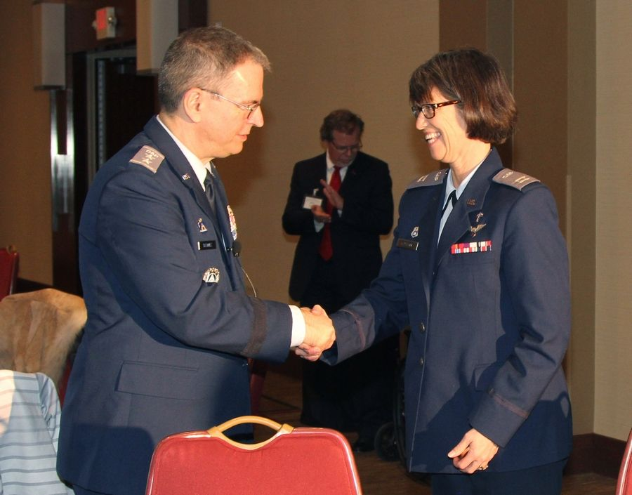 During last week's ceremony in Washington, Jill Paulson of Libertyville, shakes hands with Civil Air Patrol National Cmdr. Maj. Gen. Joe Vazquez. Paulson's grandfather founded the group in 1941, and she received a replica of the Congressional Gold Medal, our nation's highest civilian honor, which was presented to the Civil Air Patrol.