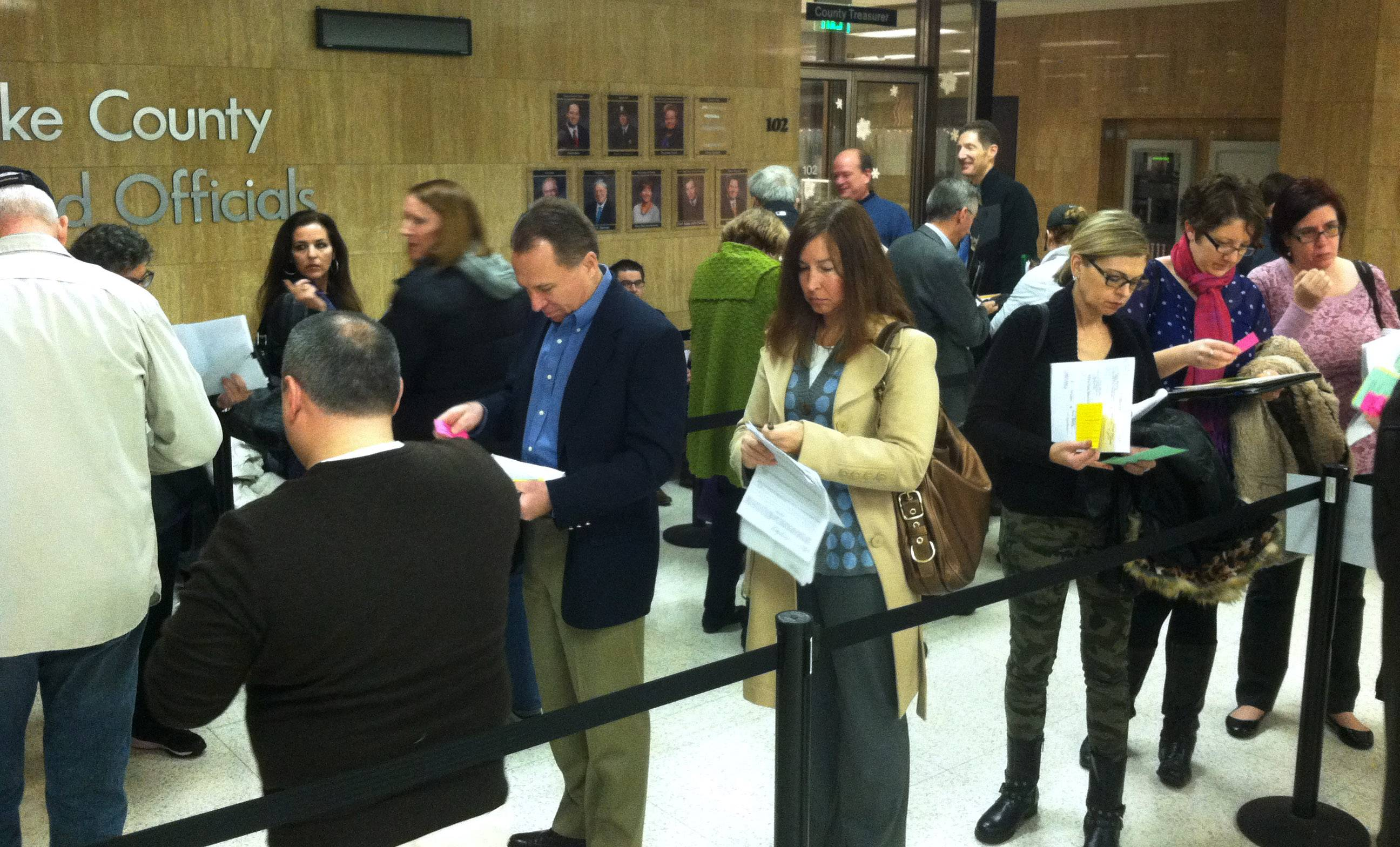 Lake County school board candidates line up in front of the Lake County clerk's office Monday morning to file election petitions required to get their names on the April 7 ballot.