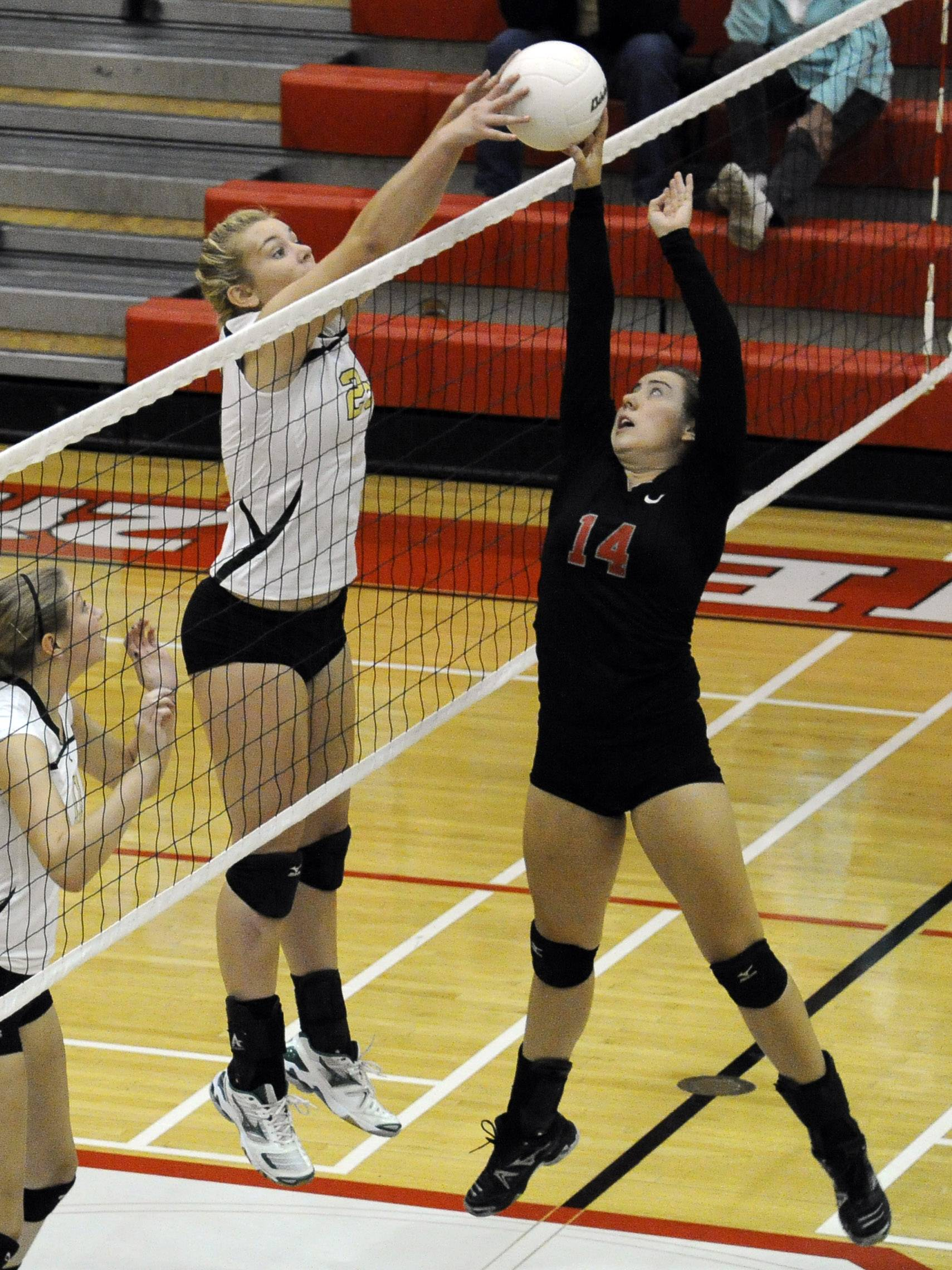 Palatine's Sarah Schiffer and Fremd's Lane Hindenburg, left, battles it out against Palatine in Mid-Suburban League play. Hindenburg is headed for a collegiate volleyball future at New Orleans.