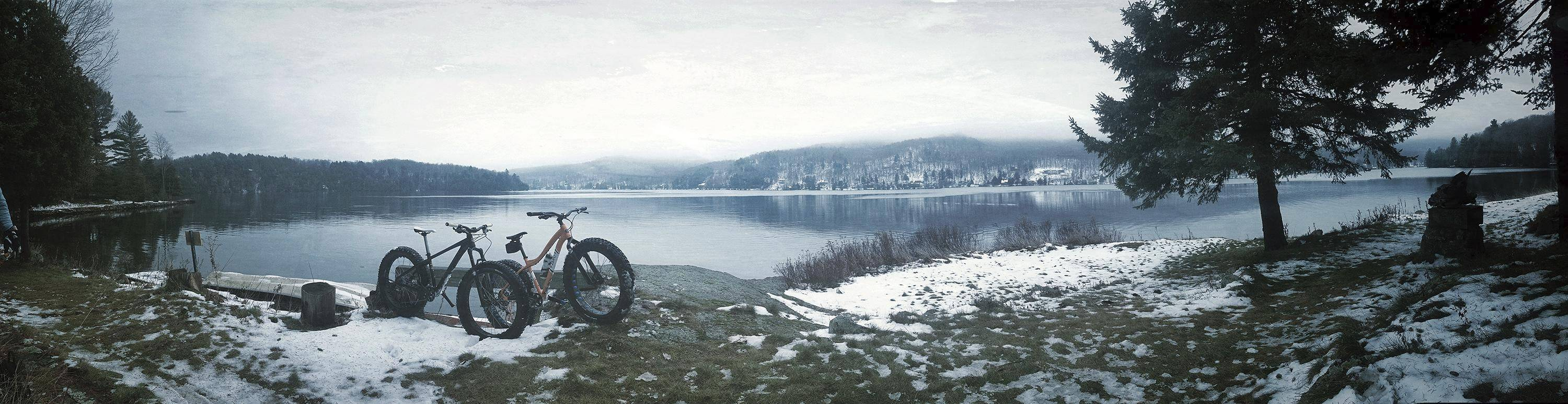 "A pair of ""fat bikes"" on the shore of Meech Lake in Quebec, Canada. The cycling industry has compared fat biking's rise in popularity with snowboarding's."