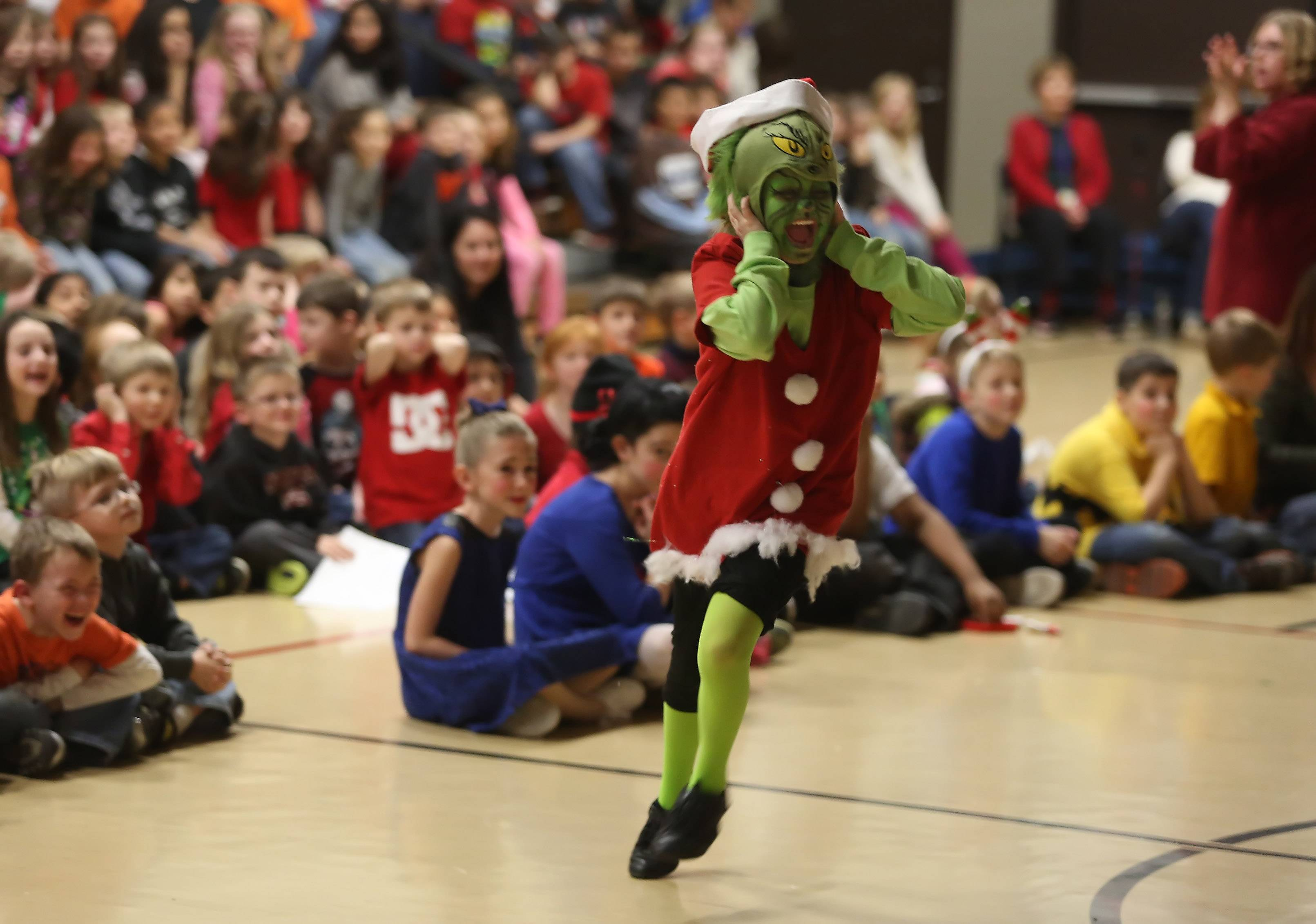 "The Grinch, played by Addison Fugelseth, howls as people from Whoville sing Christmas songs during the Gavin Central School drama club's presentation of ""How the Grinch Stole Christmas"" Wednesday afternoon at the school in Ingleside. The play and ""Charlie Brown's Christmas"" were performed for the public that night."