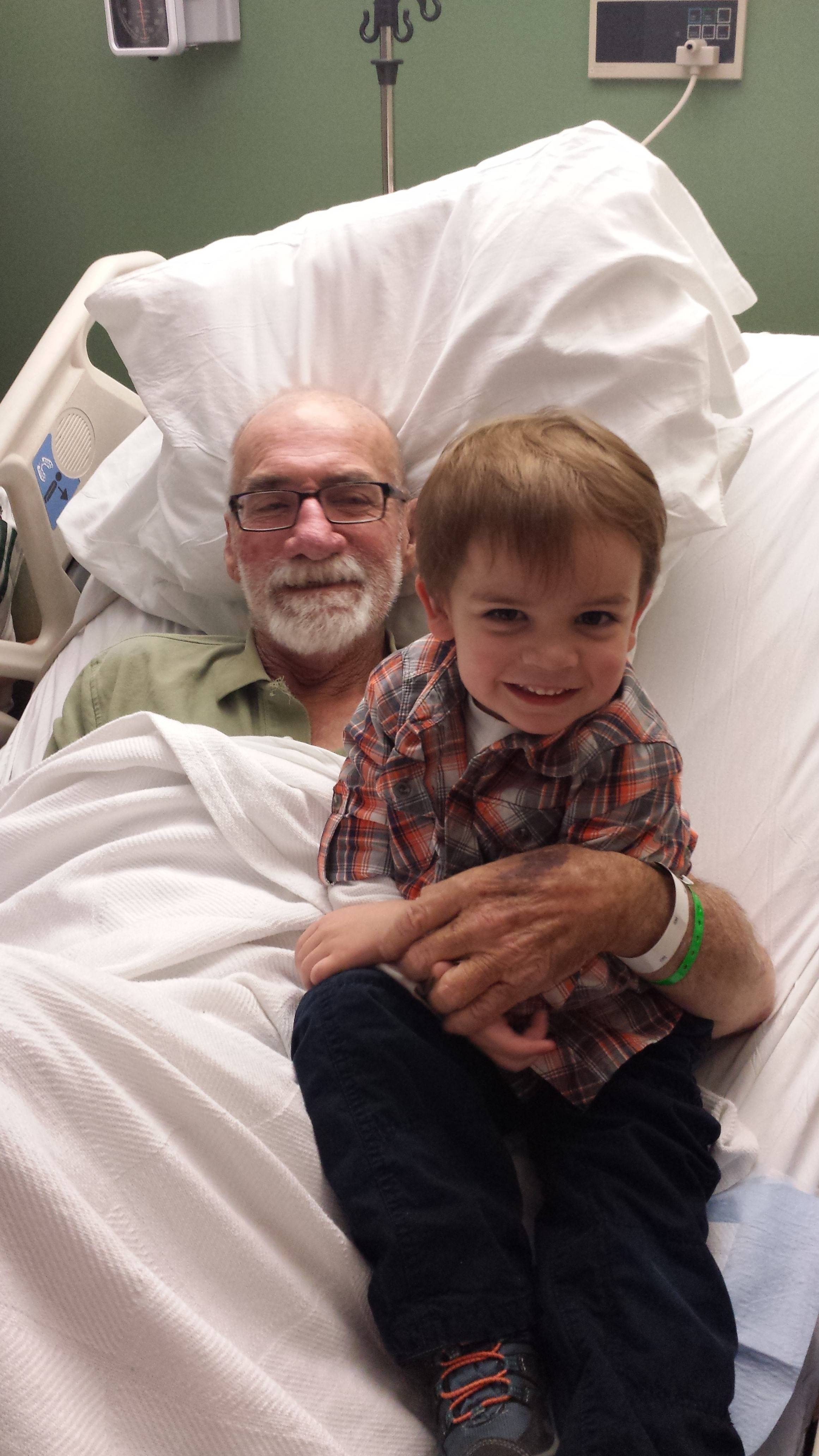 "John ""Jack"" Dempsey, 75, with his grandson Jackson, 3, recovers in the hospital after suffering a heart attack while driving a semitrailer truck in Bartlett."
