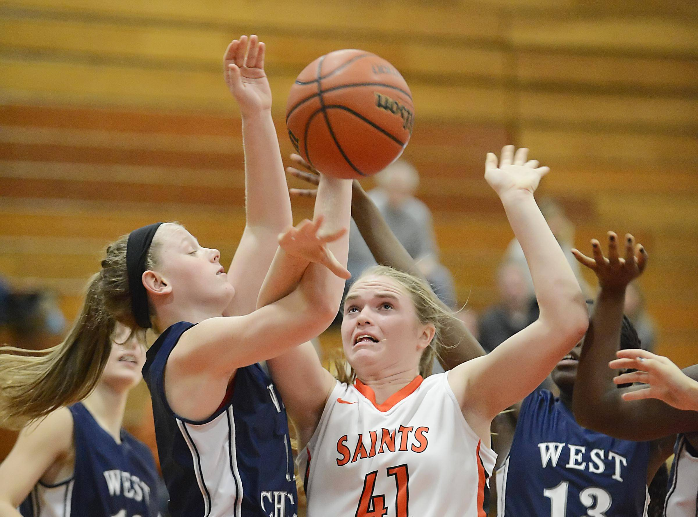 St. Charles East's Sara Rosenfeldt and West Chicago's Mariel Culloton fight for a rebound.