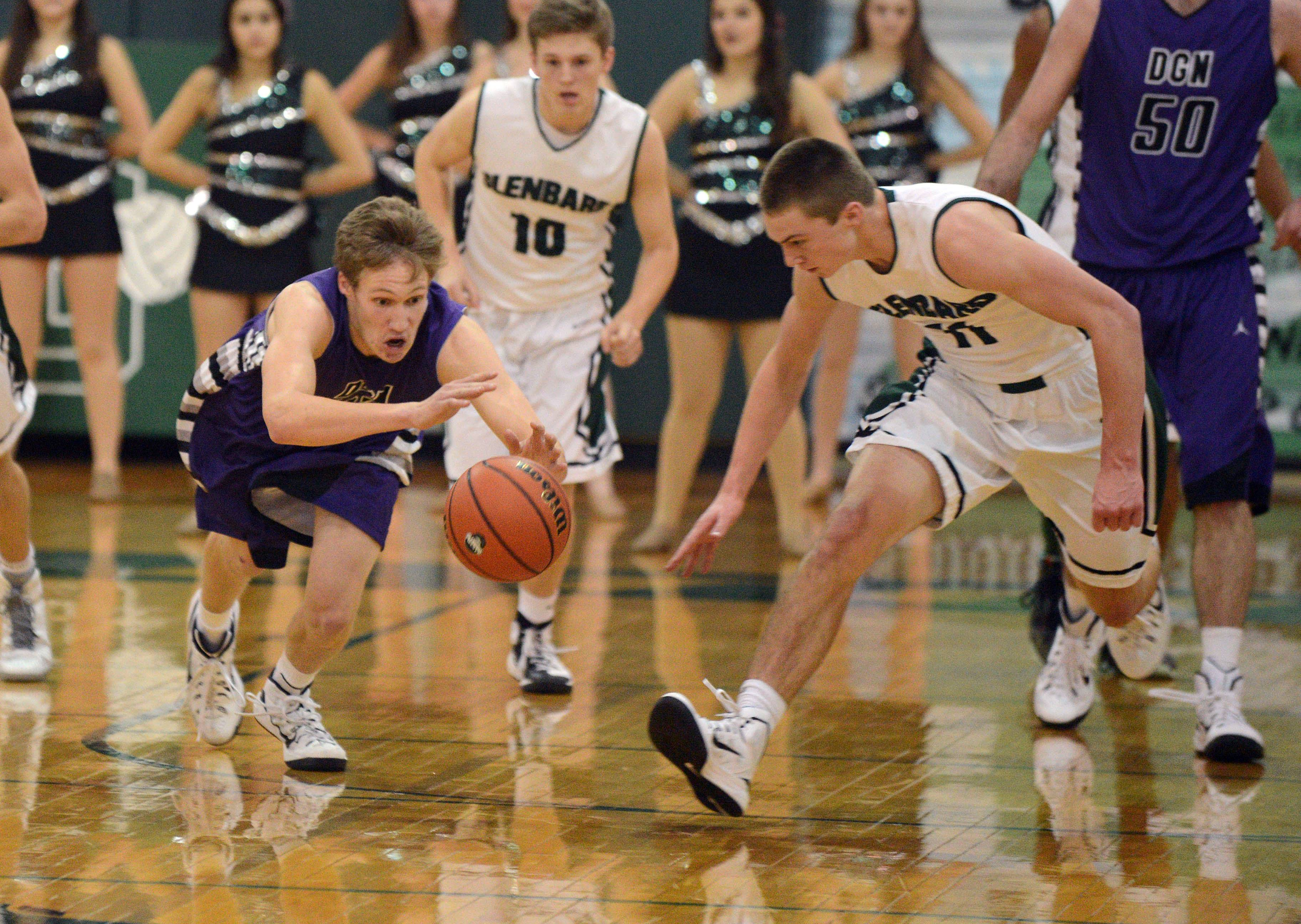Marks Bowen of Downers Grove North,left, and Aidan Gould of Glenbard West dive for the ball.