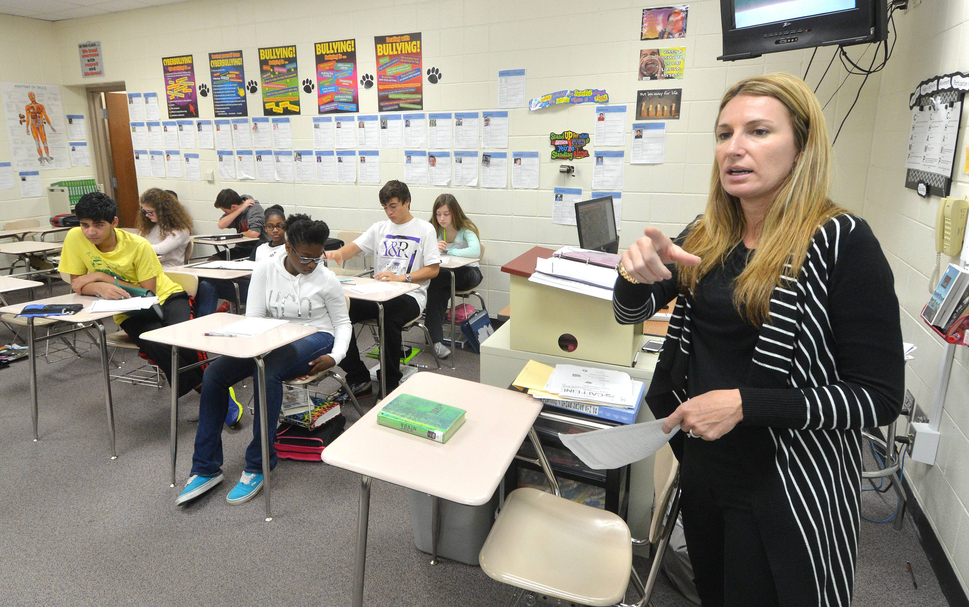 Health teacher Cristy Hefner of Crone Middle School in Naperville talks about why it is important to start educating kids early about heroin.