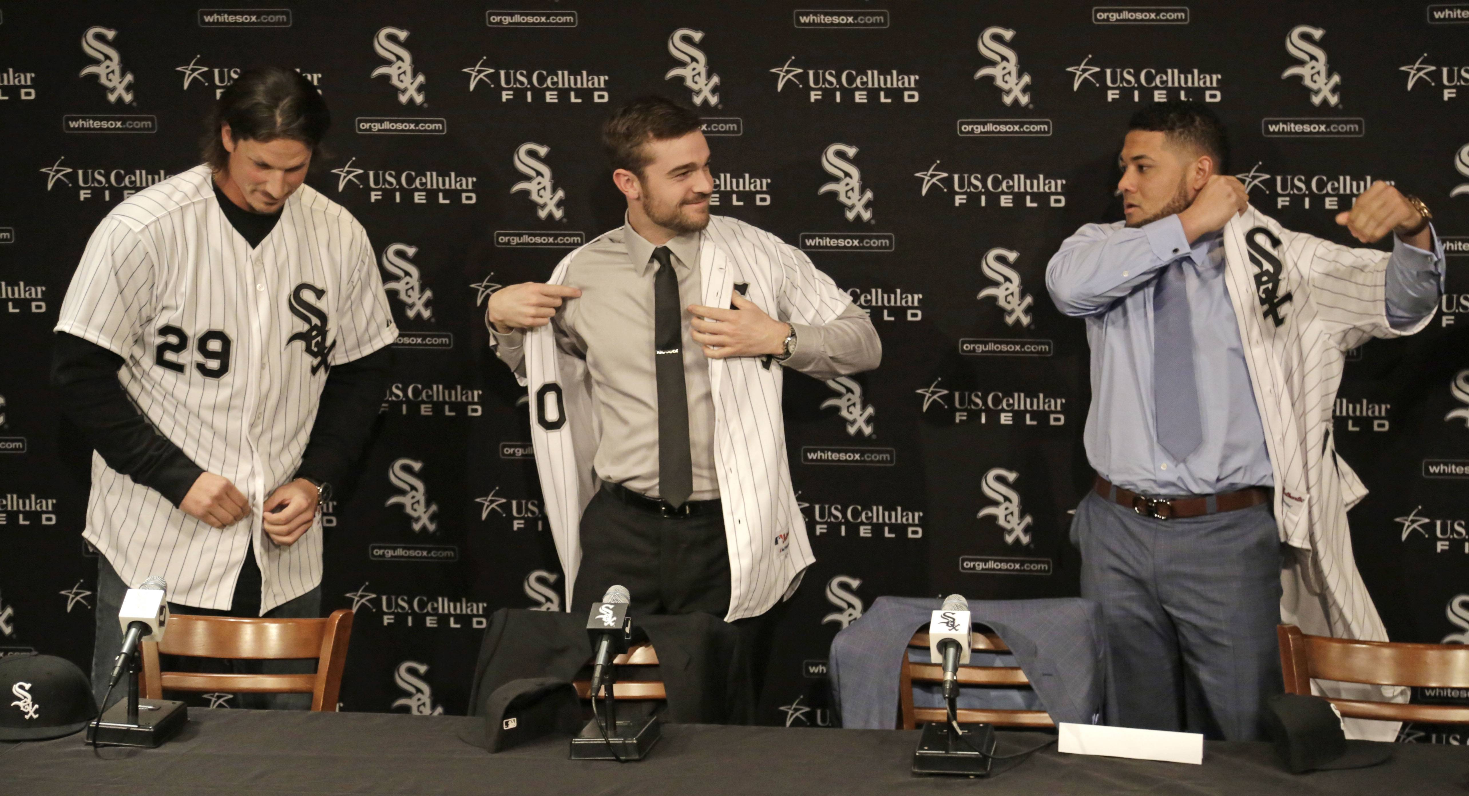 Jeff Samardzija and David Robertson and free-agent outfielder Melky Cabrera, right, don their jerseys while being introduced as the newest White Sox.