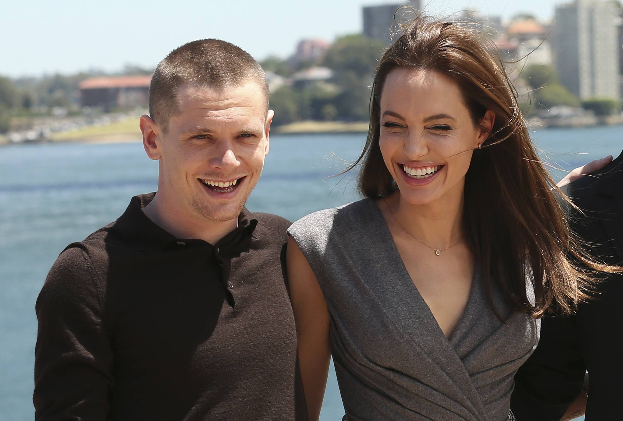 "Angelina Jolie, who directed and produced the film ""Unbroken,"" poses with actor Jack O'Connell, who plays Olympic and World War II hero Louis Zamperini in the movie."